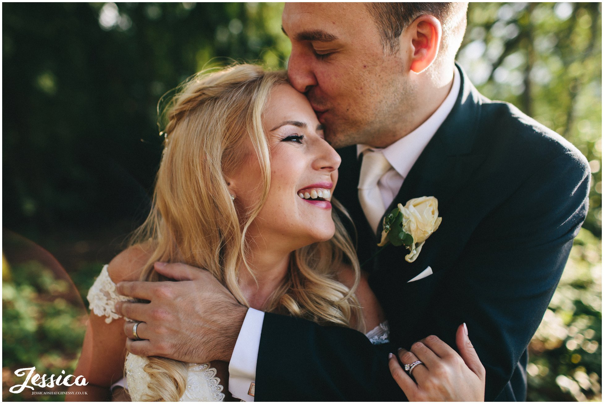 groom kisses brides forehead at nunsmere hall