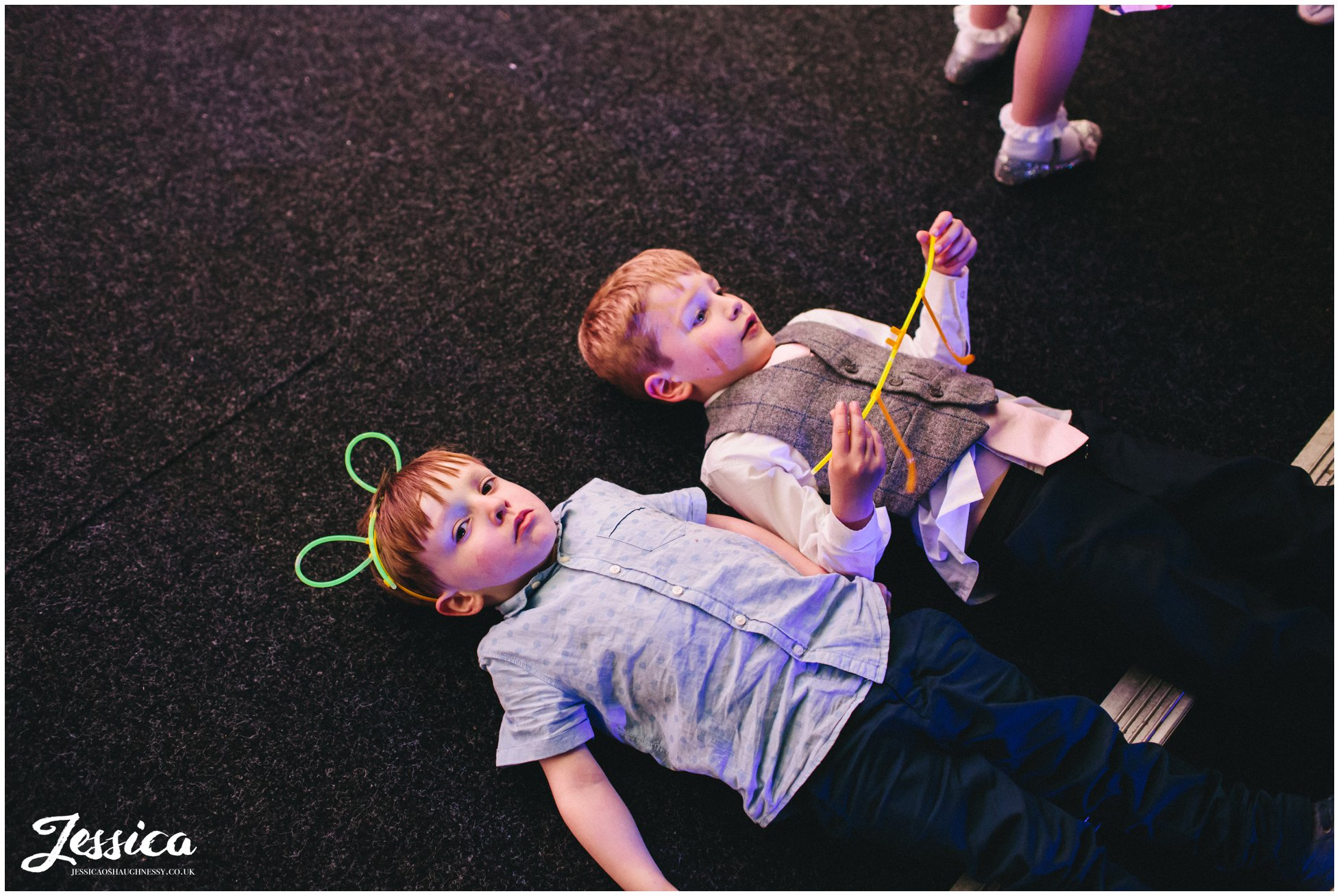 children wear glow stick ears at a wedding in cheshire