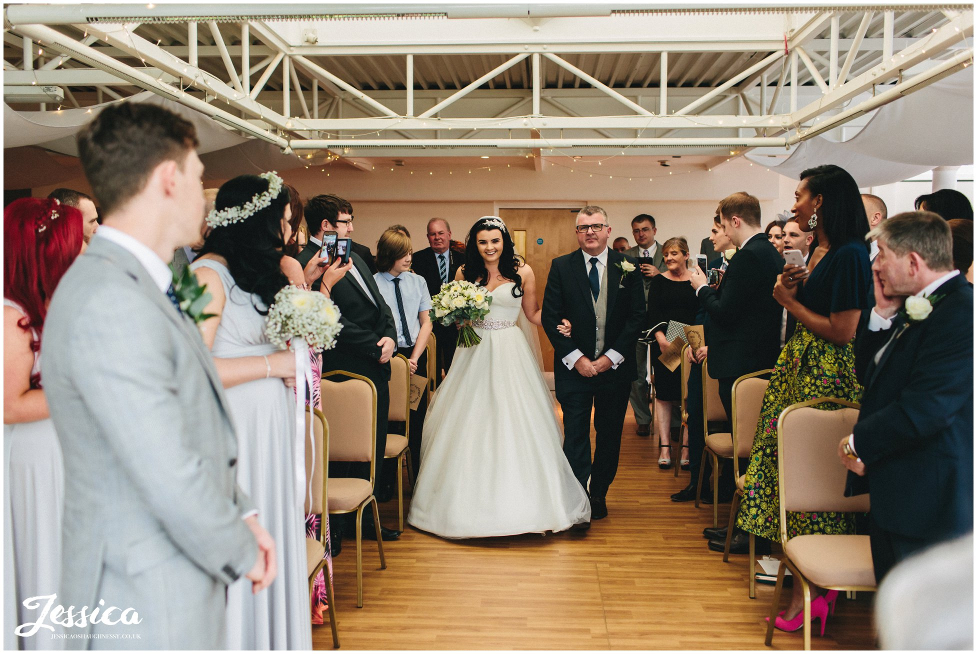 wirral wedding photographer - bride walks down aisle on her wedding day