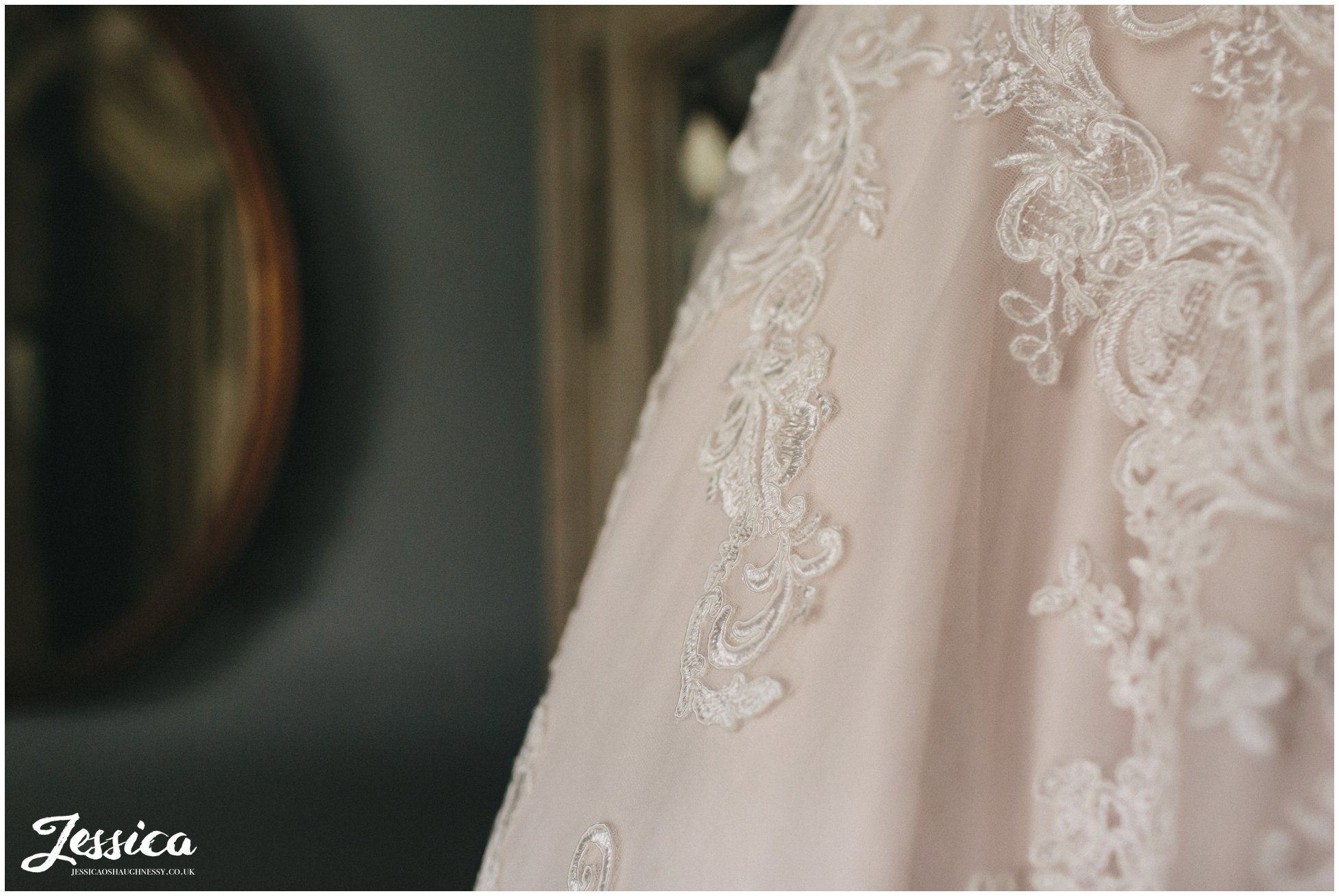 close up of lace detail on wedding dress
