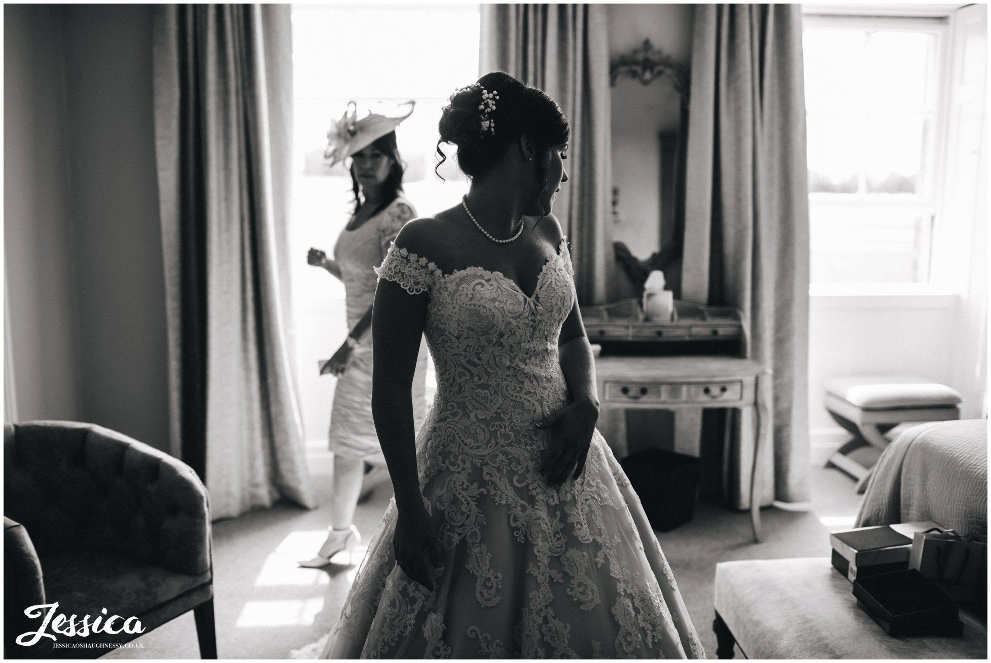 black and white photograph of the bride in her wedding dress