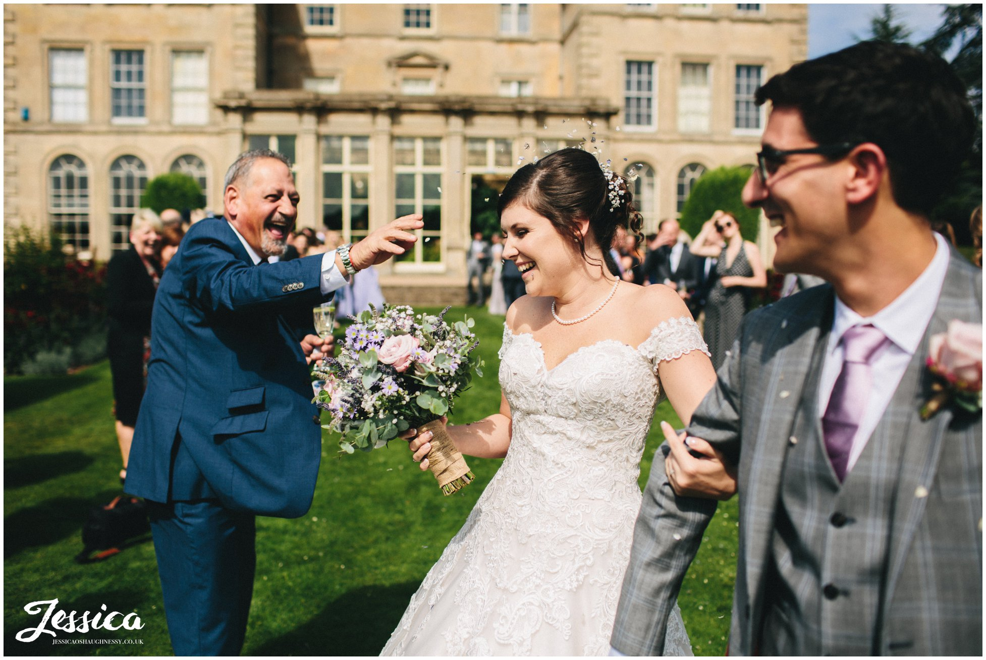 guest throws confetti in brides face