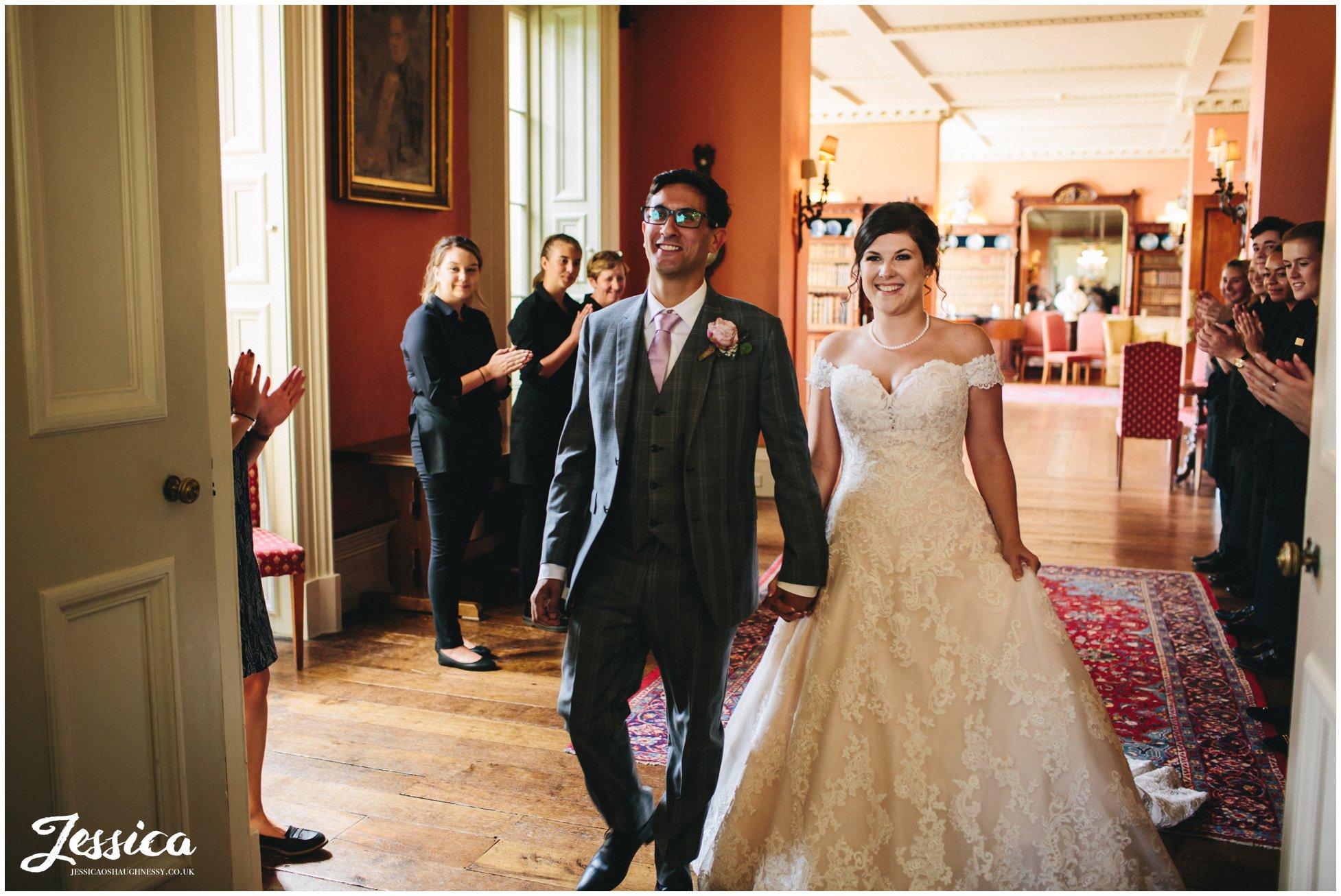 bride & groom get announced into their wedding breakfast