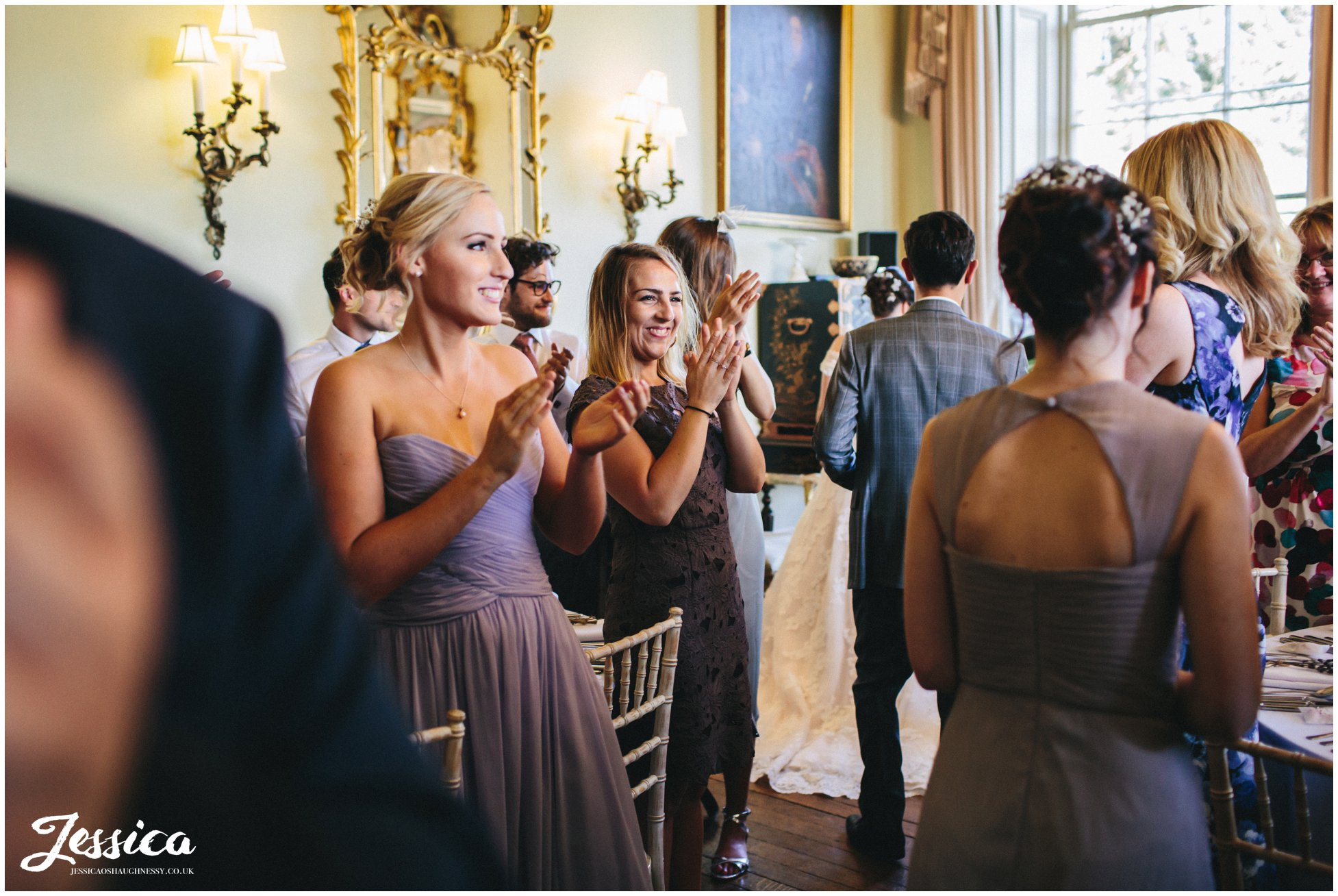 guests applaud newly wed's entrance