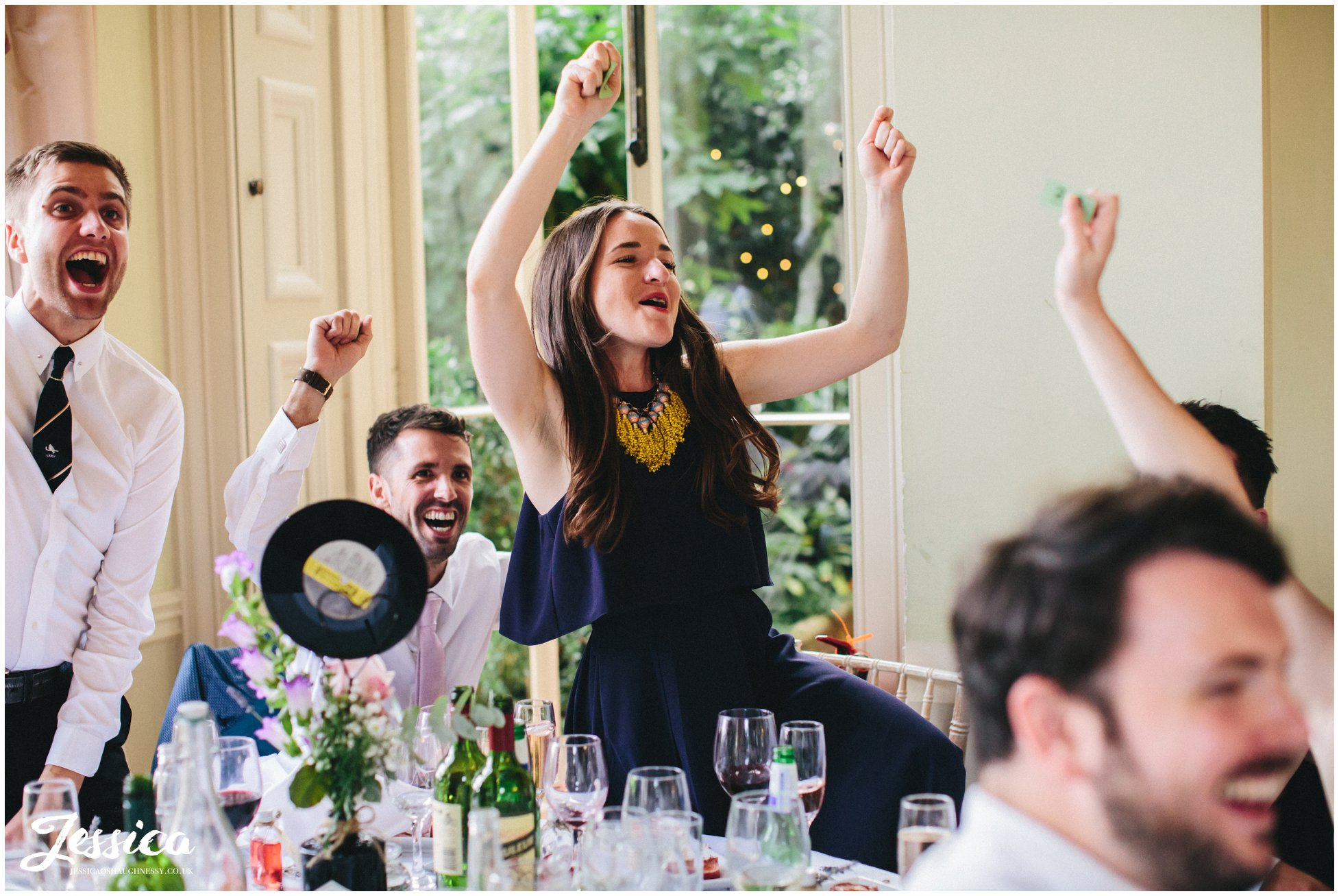 guests celebrate winning the prestwold hall wedding raffle
