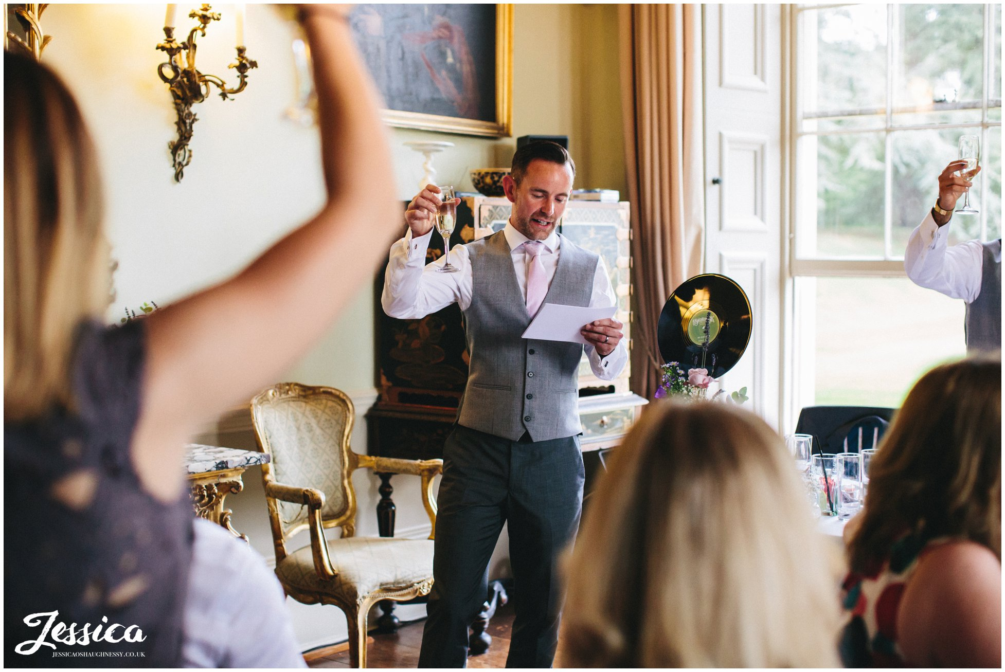 best man raising a toast to the new couple