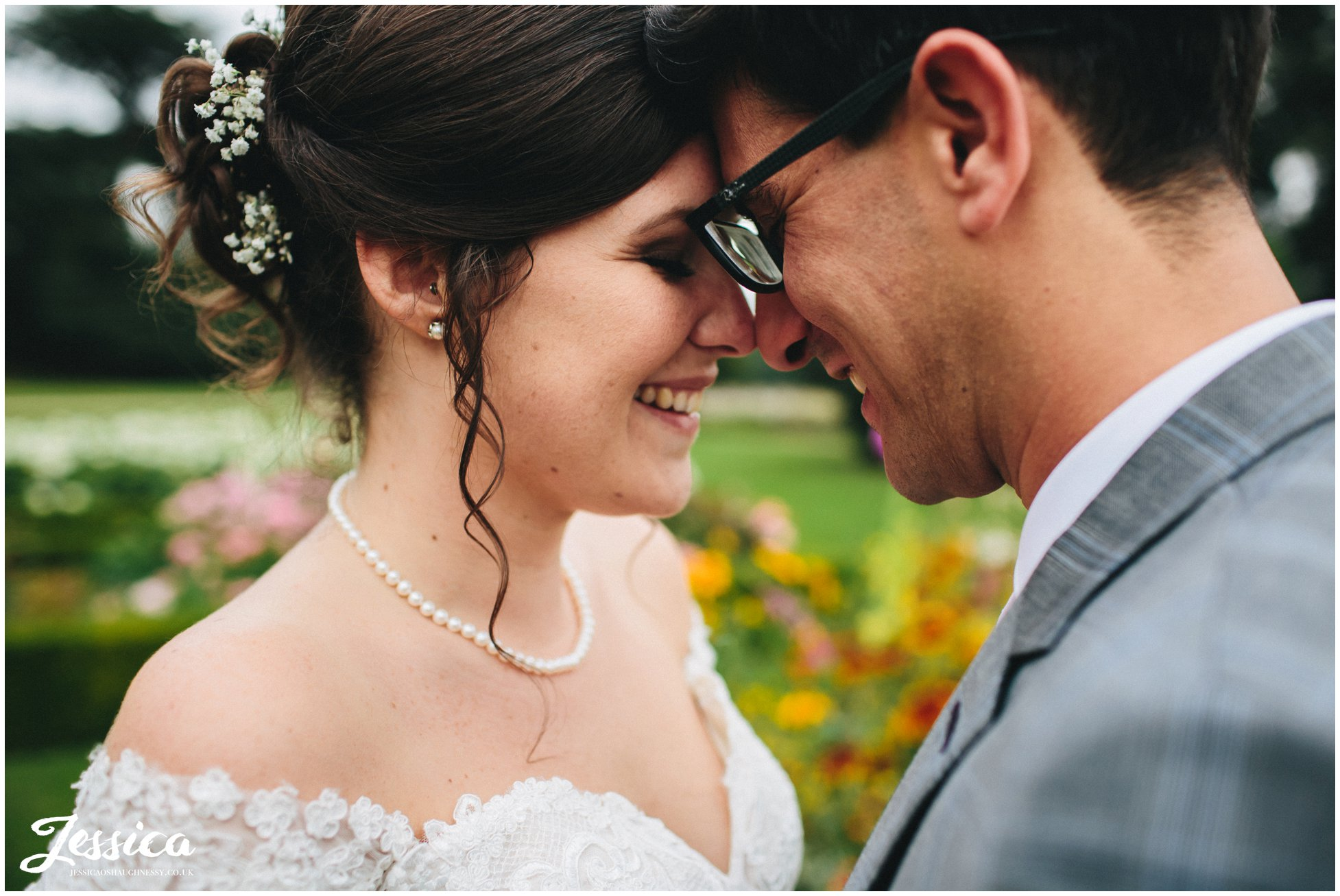 close up of bride and groom smiling - prestwold hall wedding photography