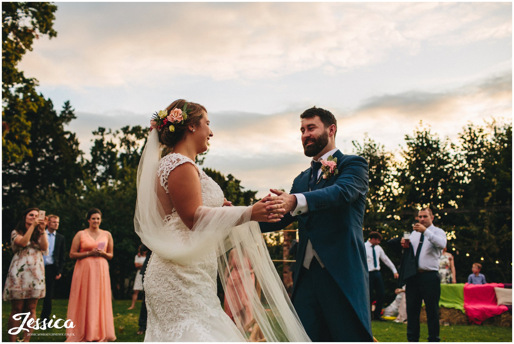 bride & groom share first dance outside
