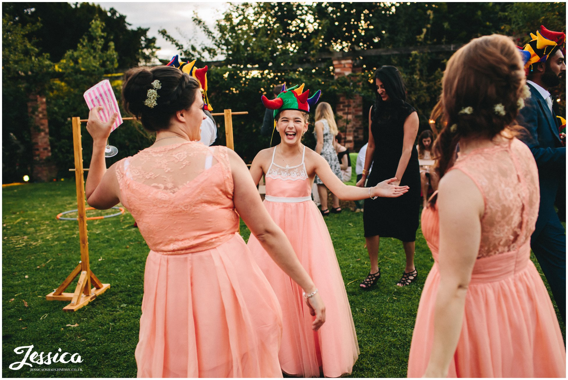 bridesmaids laughing wearing joker hats