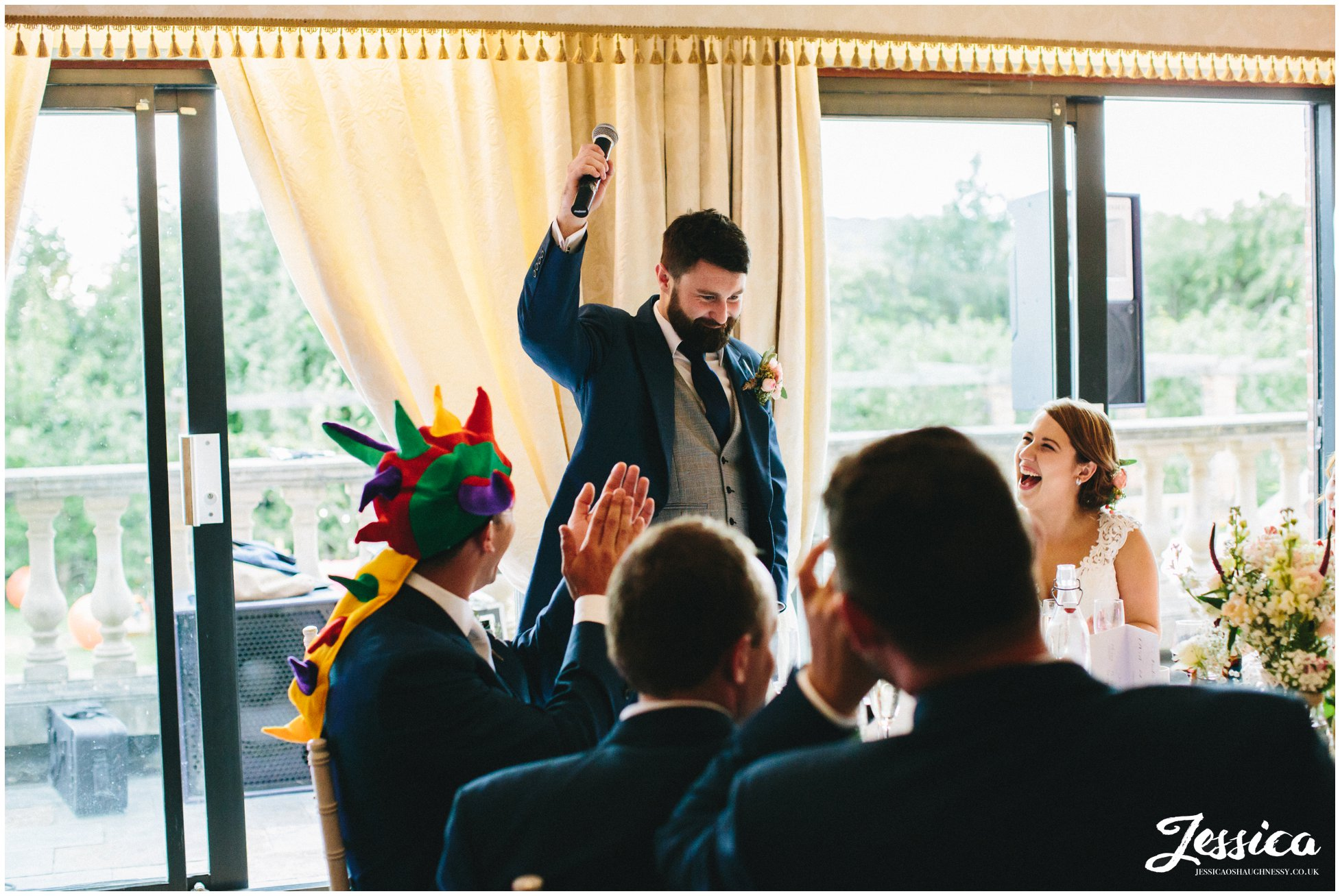groom gives a speech on his wedding day at willington hall