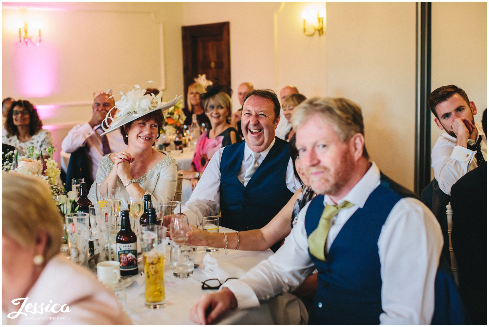 family enjoy the grooms speech at cheshire wedding