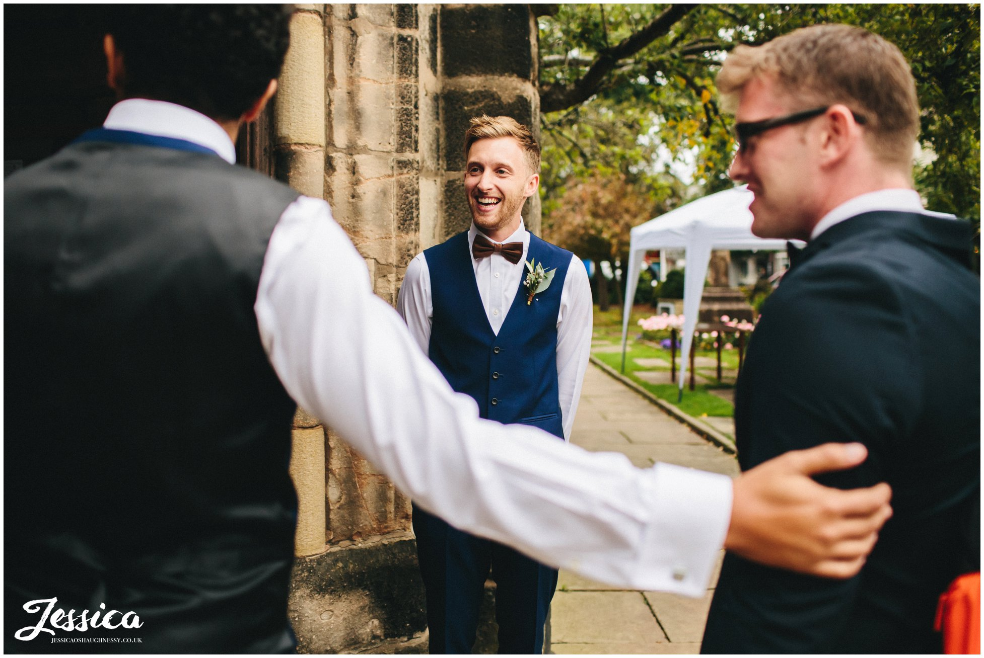 groomsmen greet guests at cheadle church