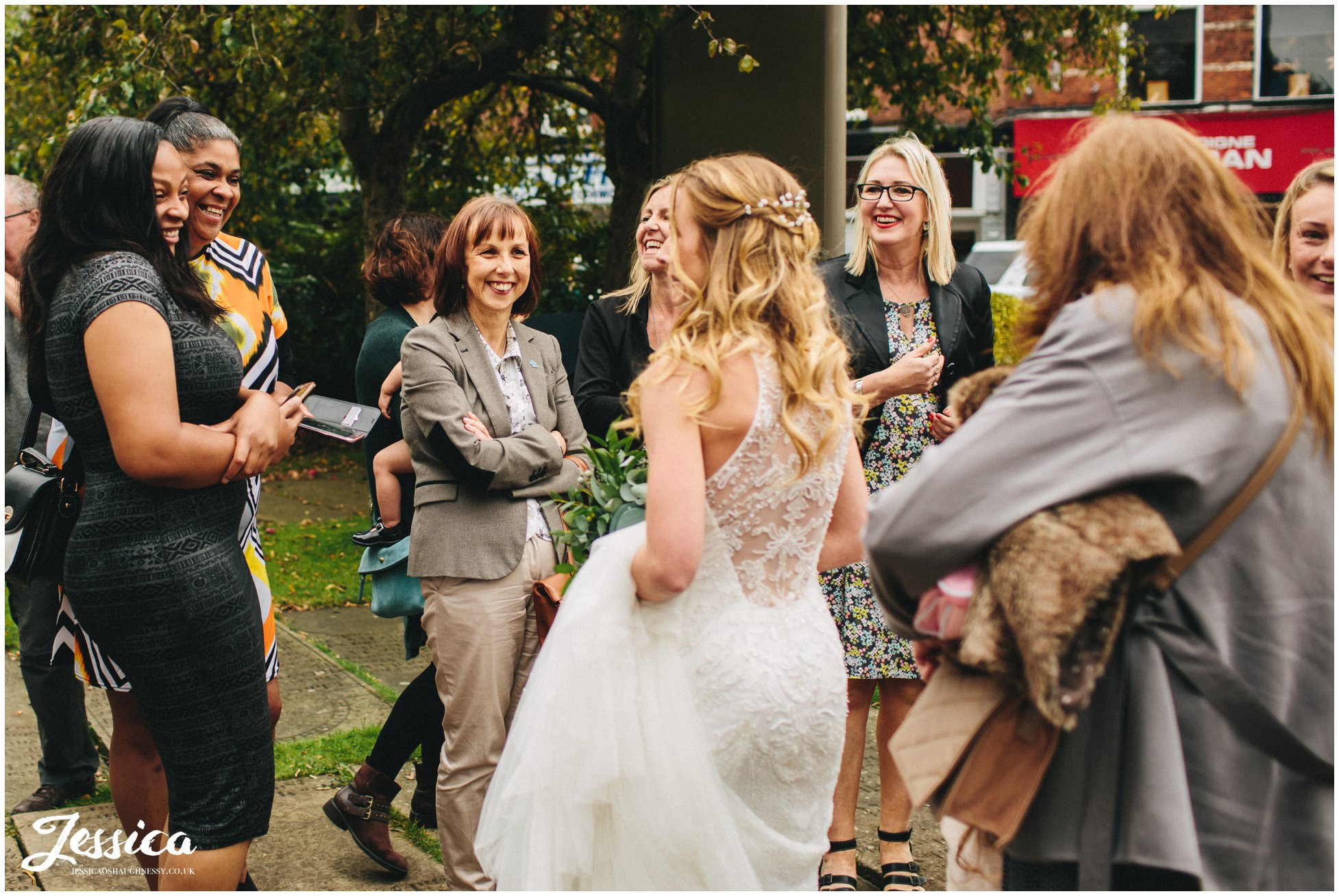 bride greets her friends after the ceremony in cheadle