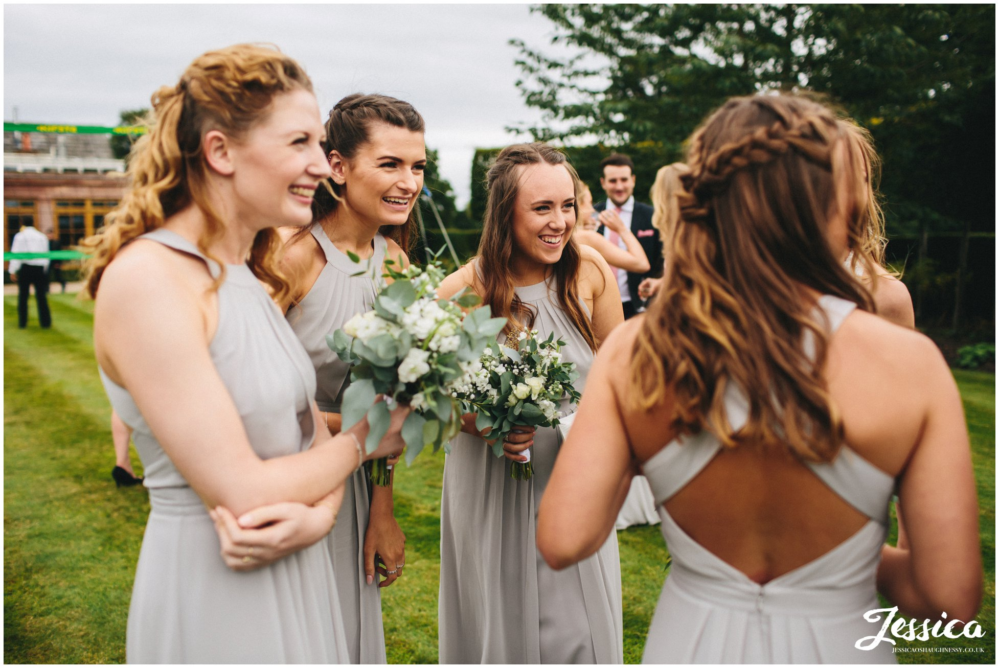 merrydale manor in cheshire - bridesmaids laughing together