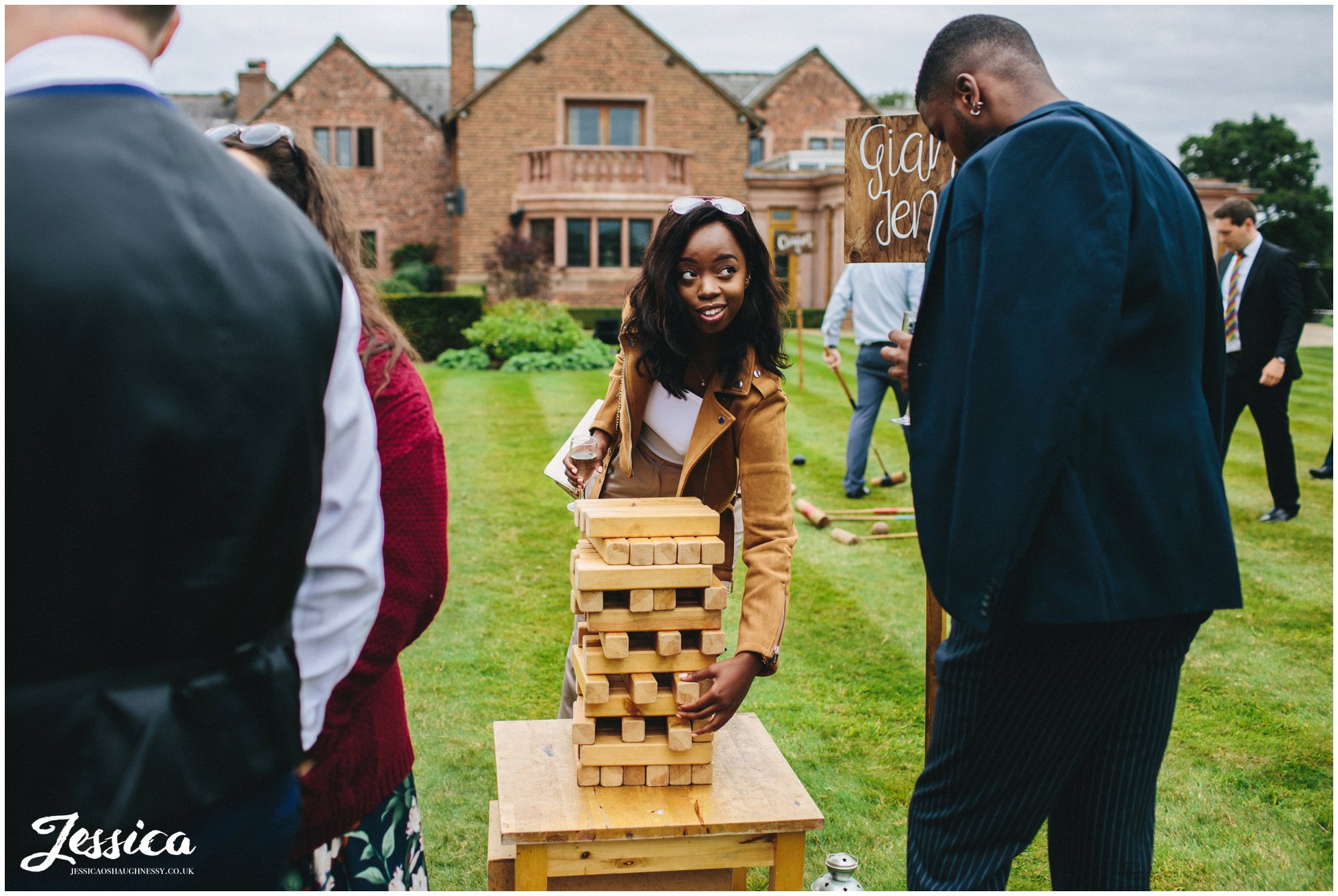 wedding guests play jenga on the lawn in cheshire