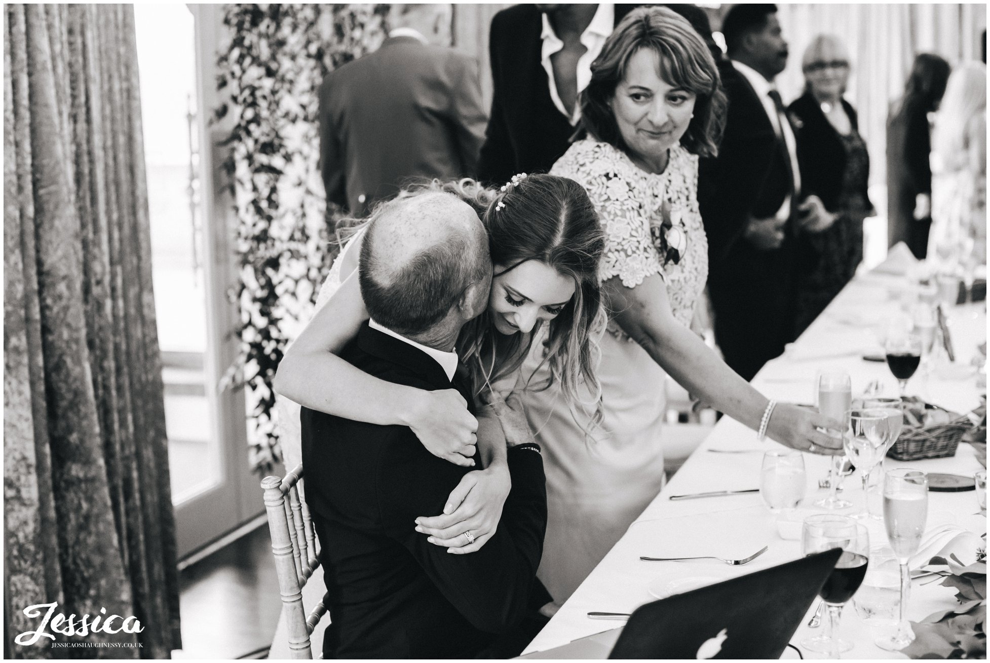 bride hugs her father in thanks to his speech