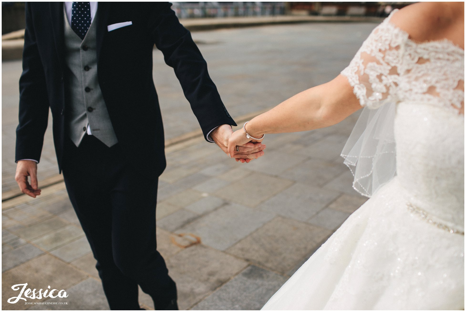 close up of husband and wife holding hands