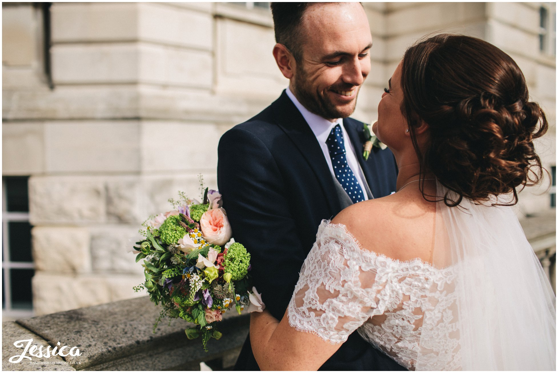 husband smiles at his new wife in liverpool