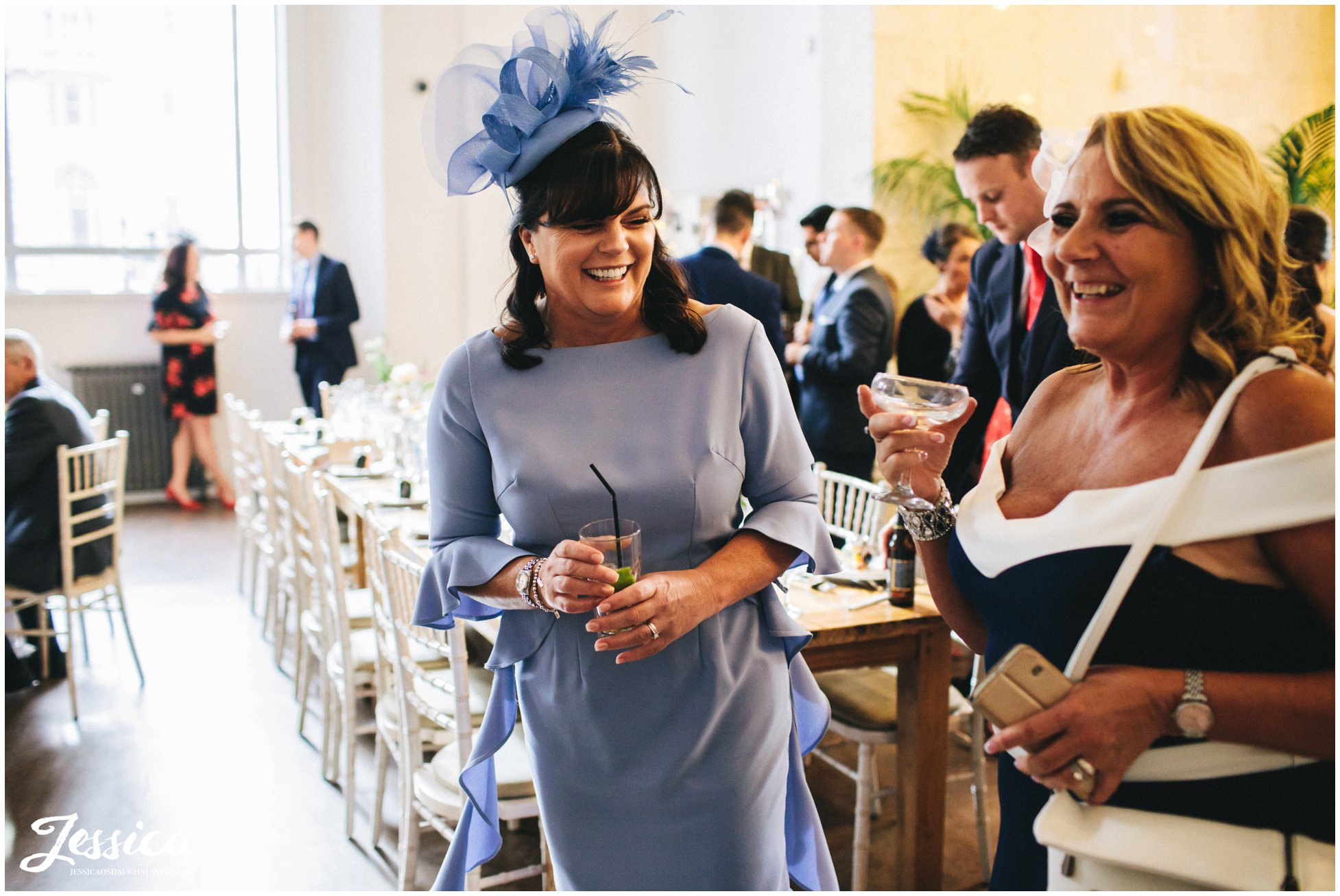 mother of the bride laughing with her sister