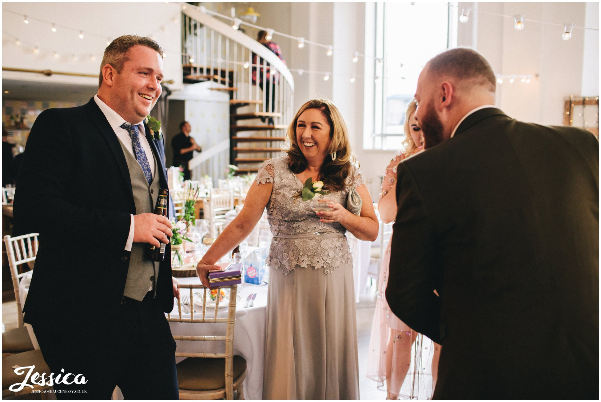 guests laughing during the drinks reception