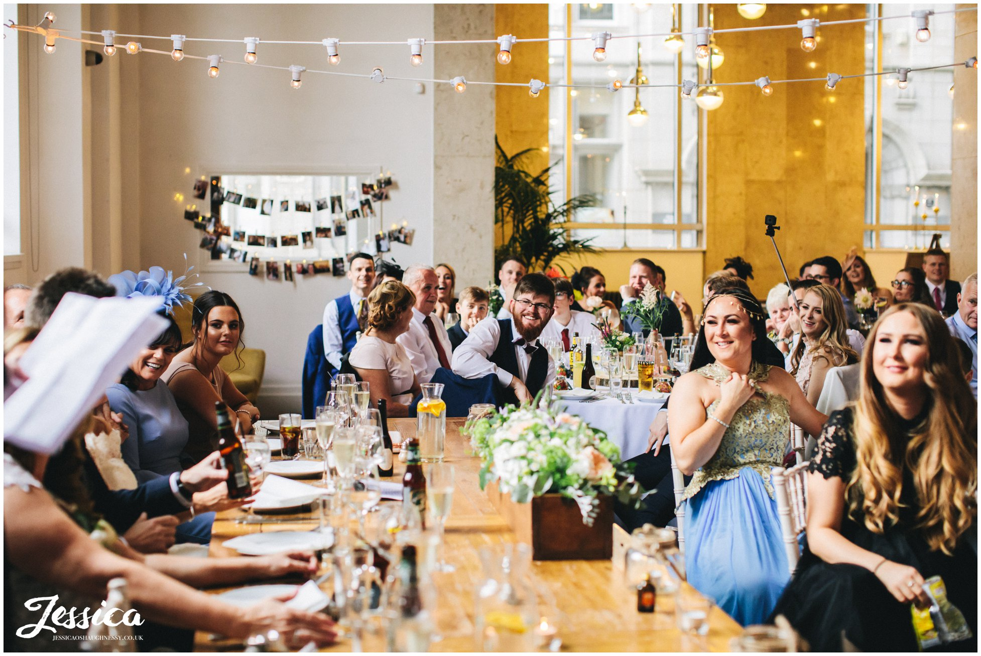 wedding guests laughing during the speeches at oh me oh my
