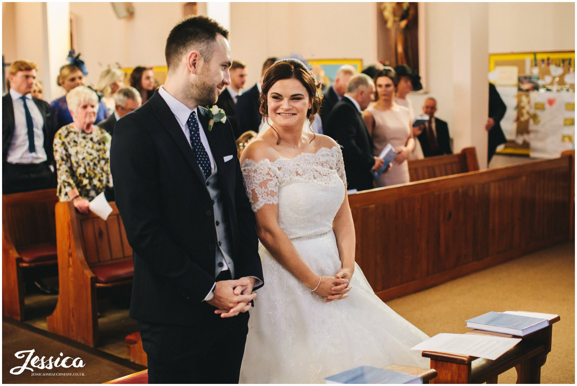 bride looks at groom during their liverpool wedding ceremony