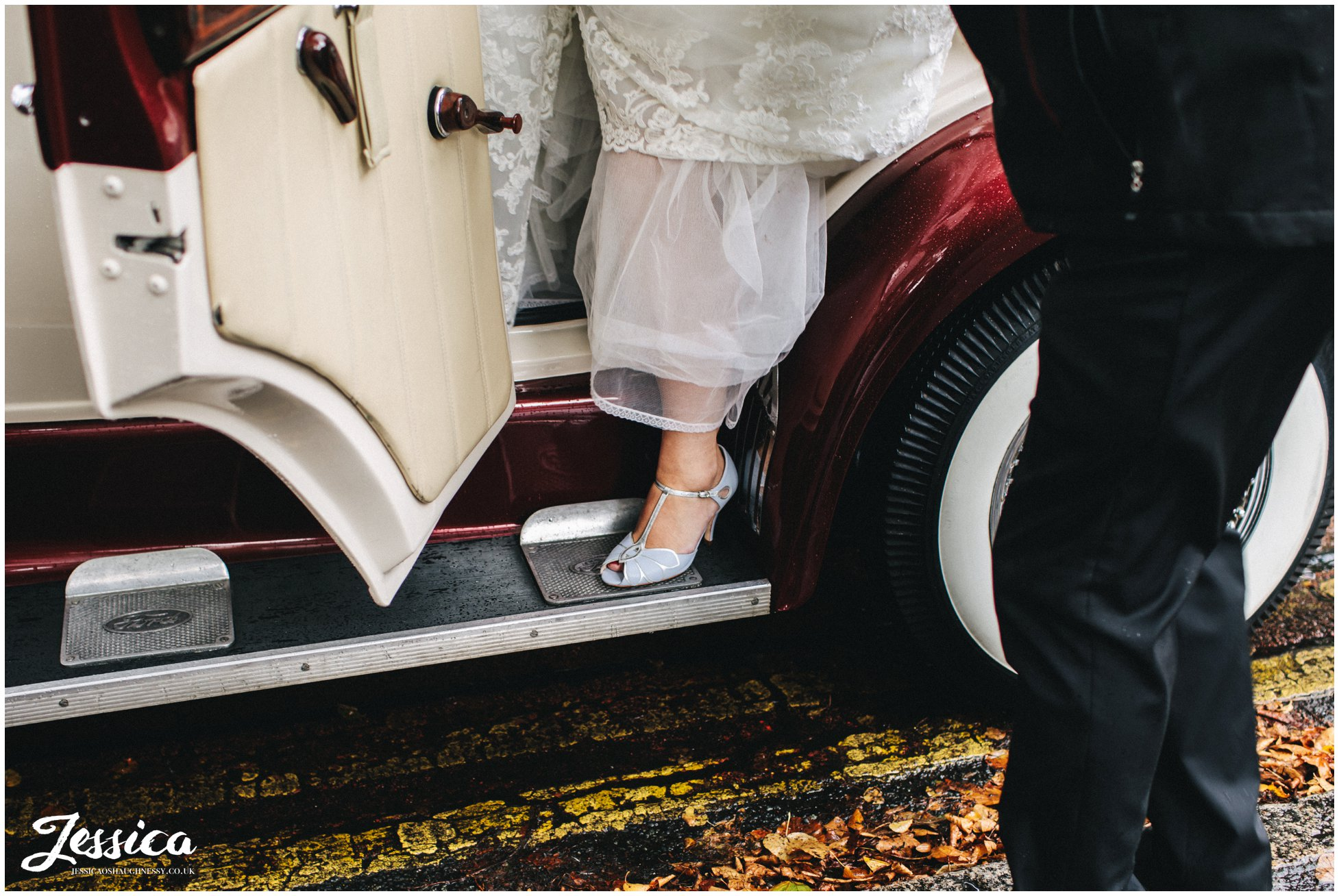 bride gets out of the wedding car at Wavertree Holy Trinity Church