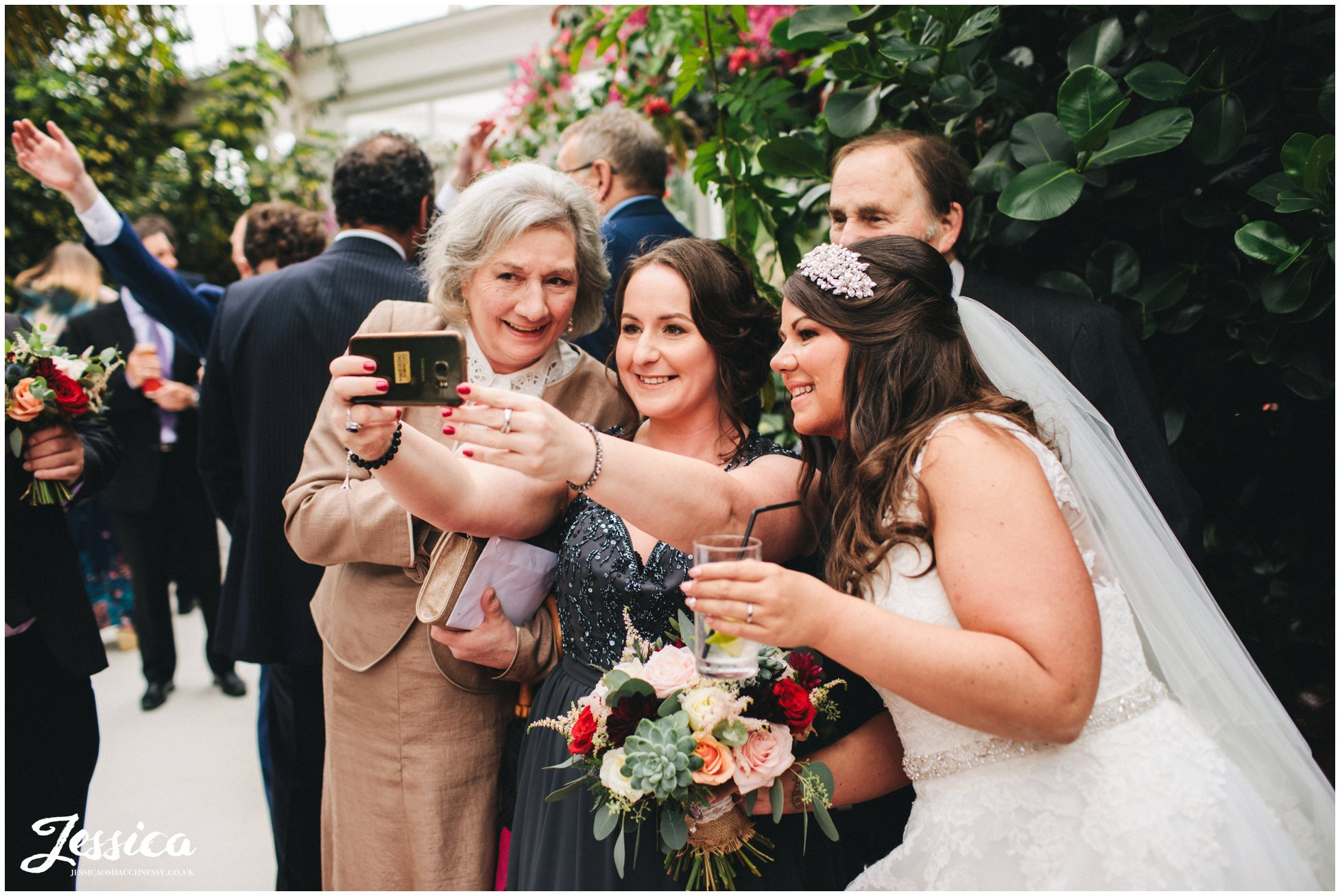guests take a selfie with the bride