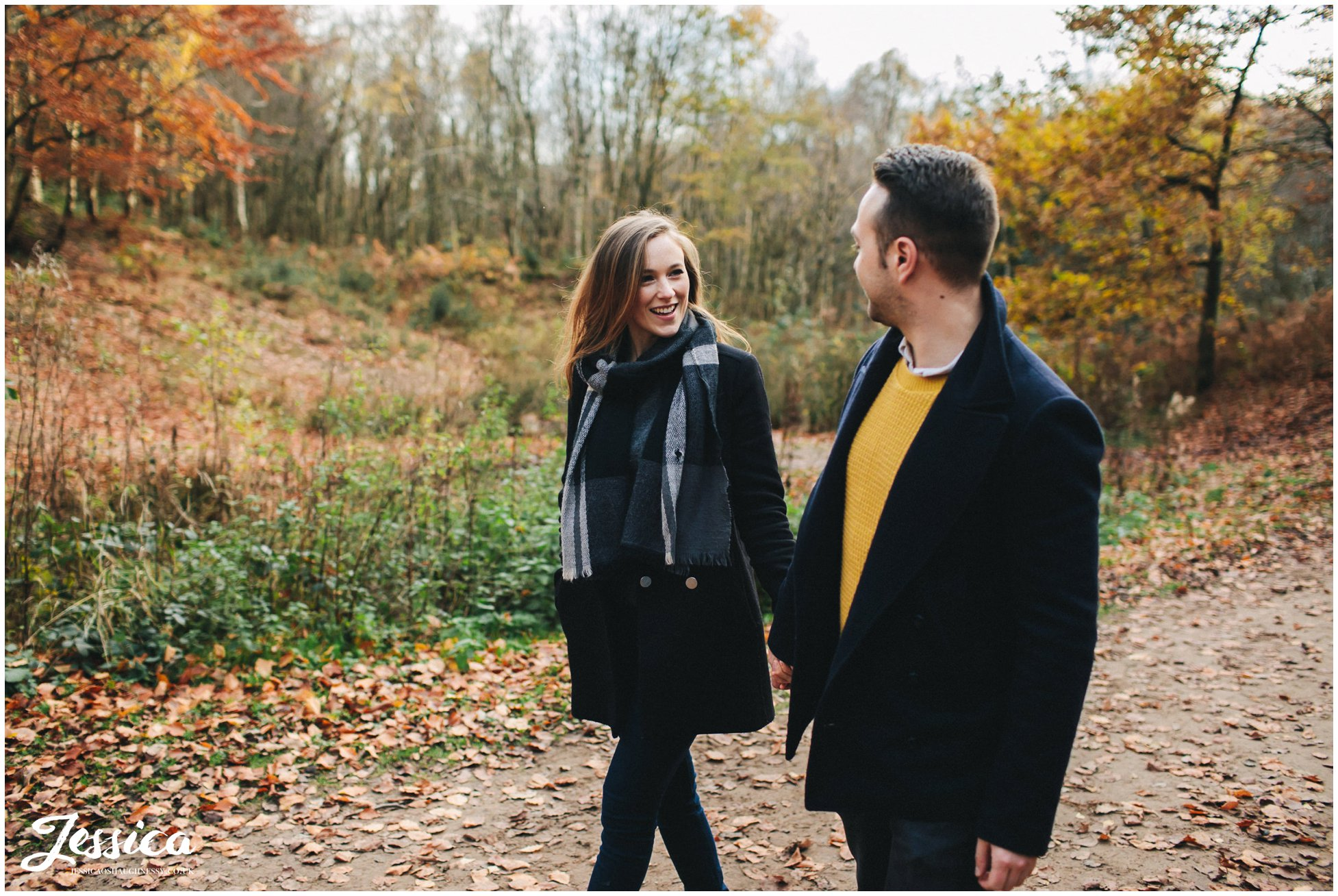 girl smiles at her fiance - a cheshire engagement shoot