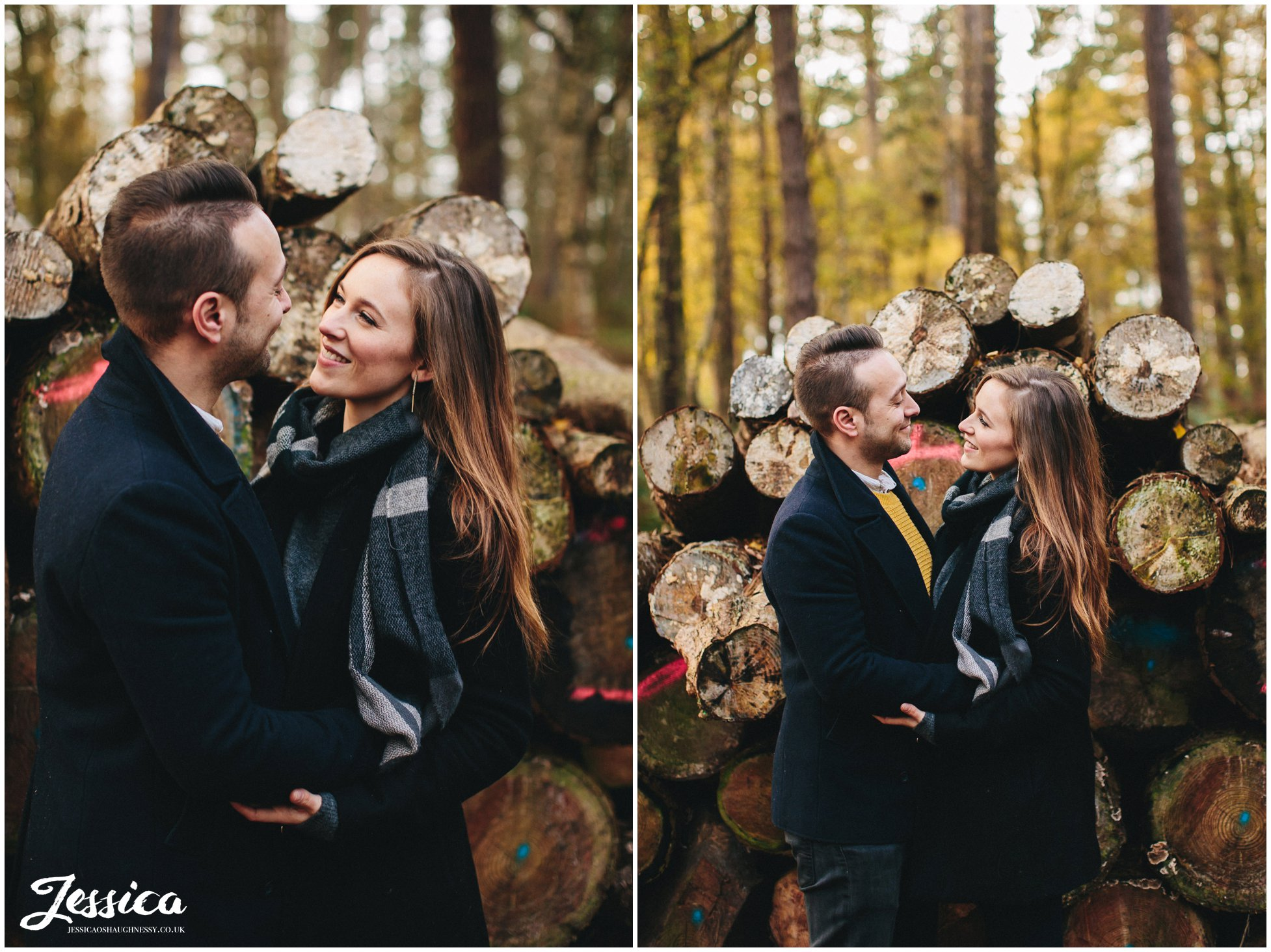 couple kissing in front of logs, delamere forest