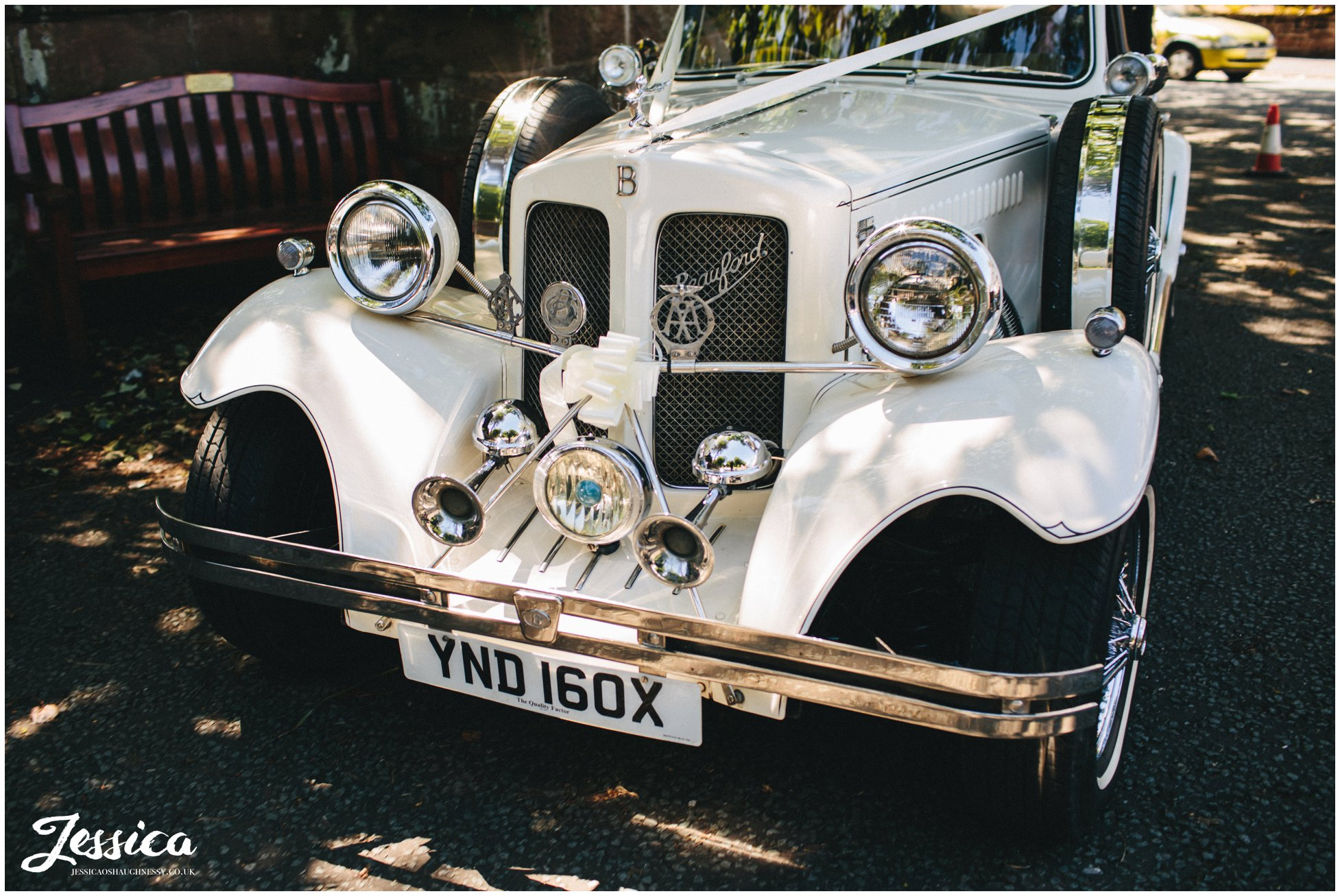 classic car arrives at the church with the bride & her father