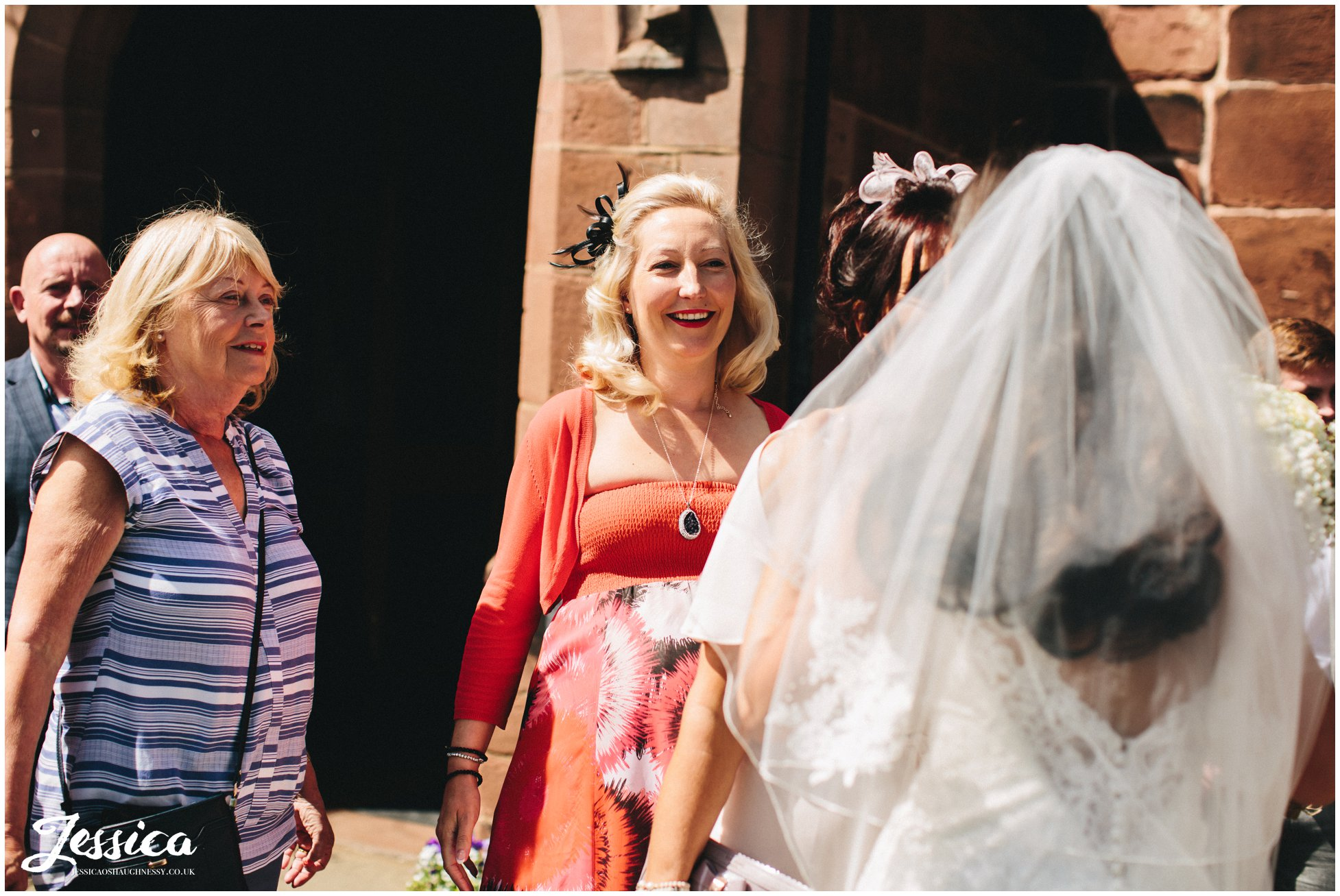 guests celebrate the new marriage