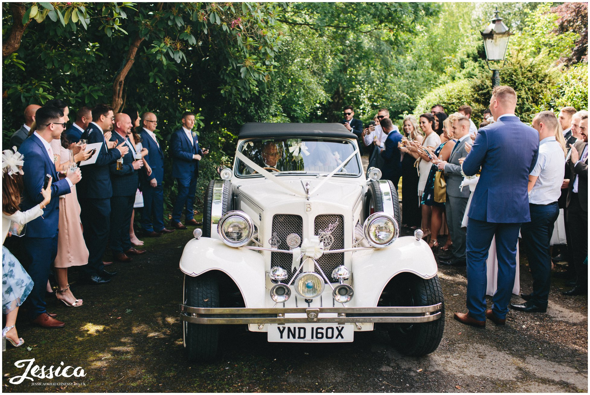 wedding car arrives at brook hall hotel