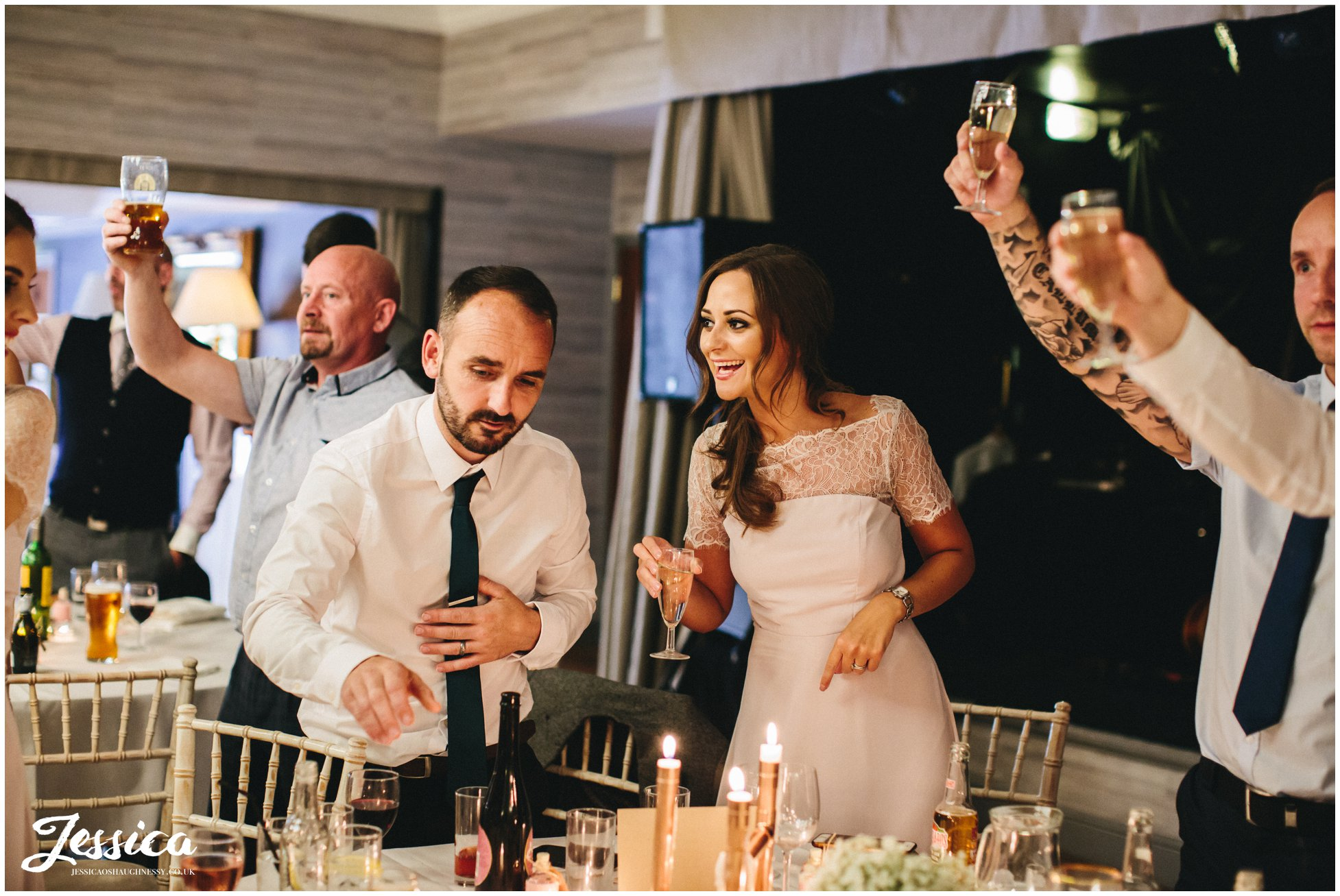 guests cheer as newly wed's enter