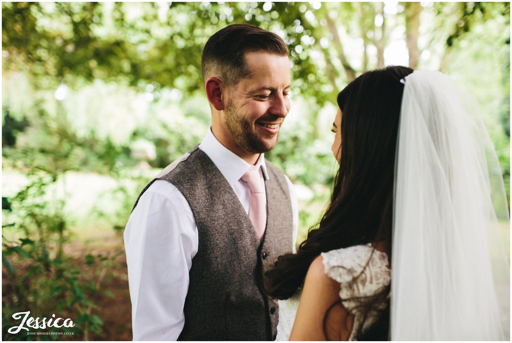 groom looks lovingly at his new wife