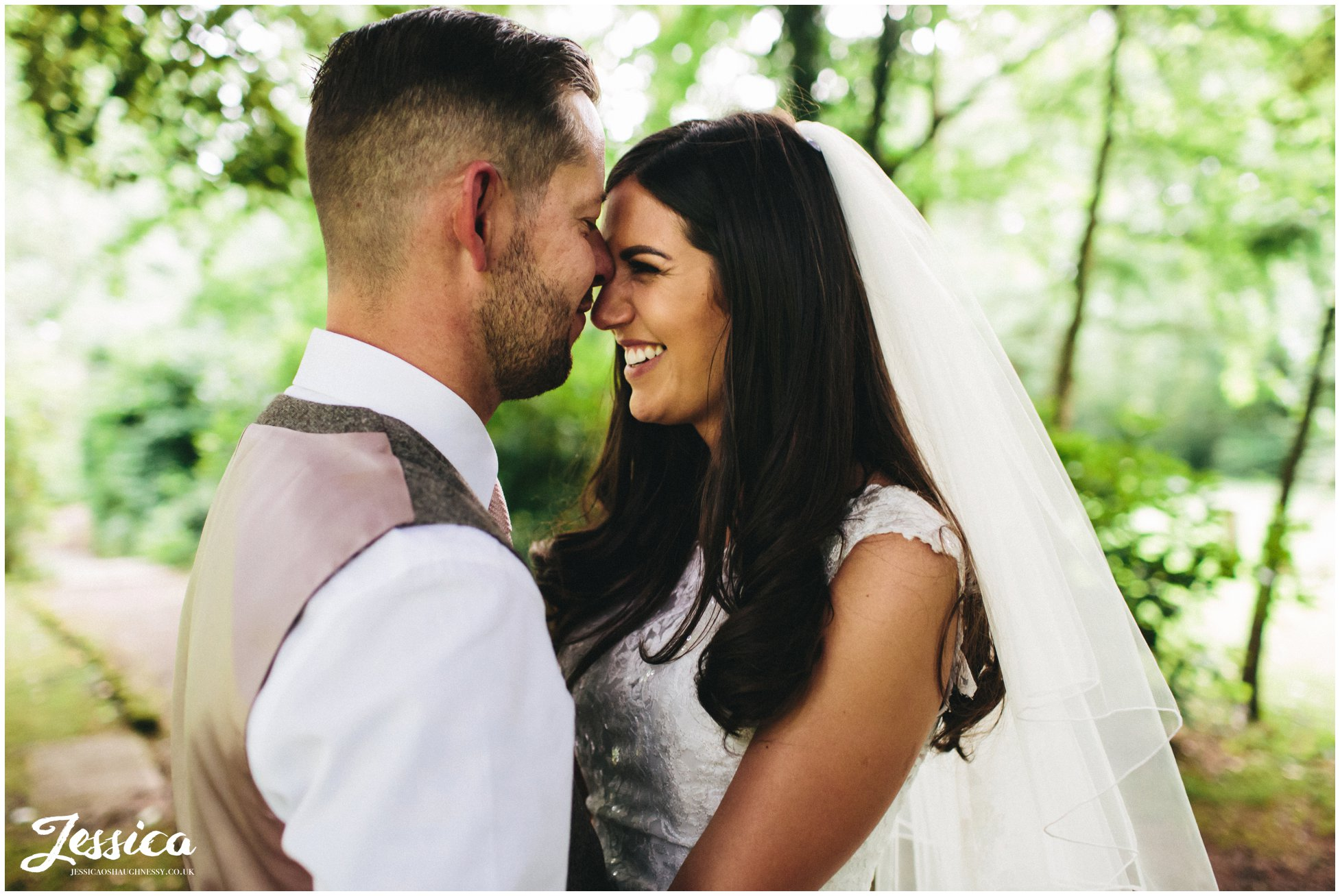 husband kisses his wife's forehead at brook hall hotel on the wirral