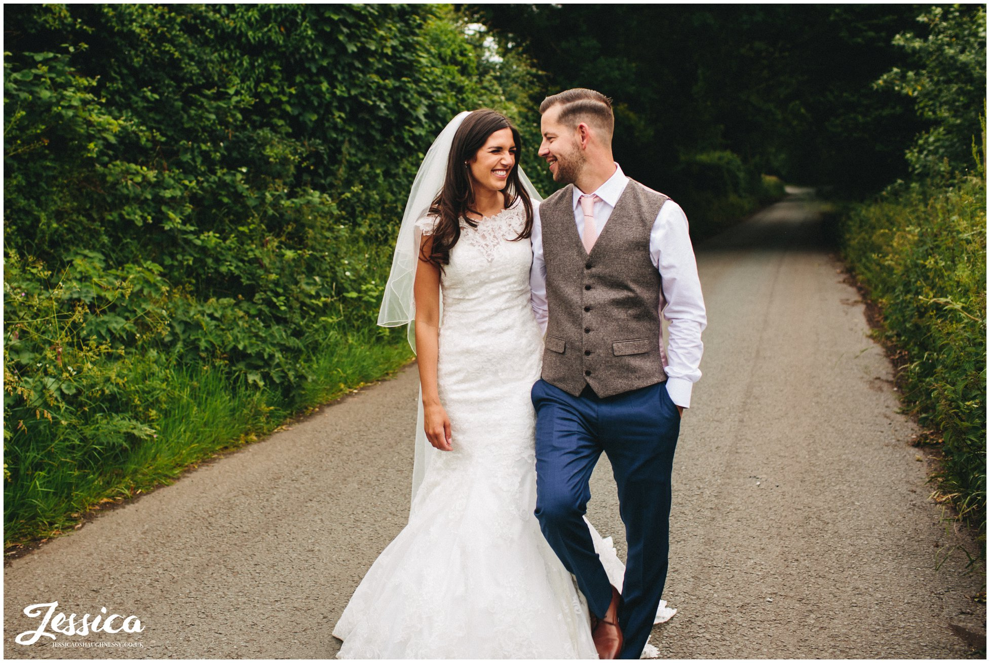 newlywed's walk down country lanes outside their wirral wedding venue