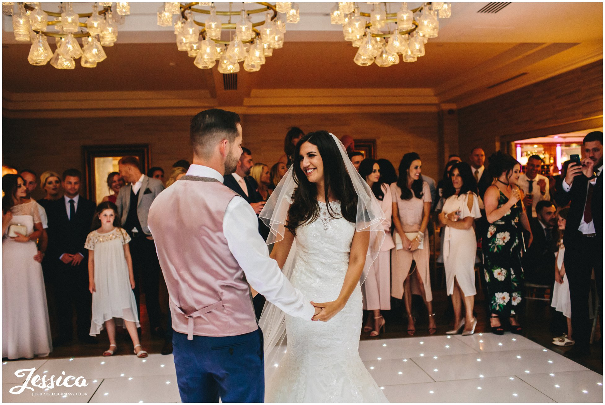 bride & groom share their first dance as husband & wife