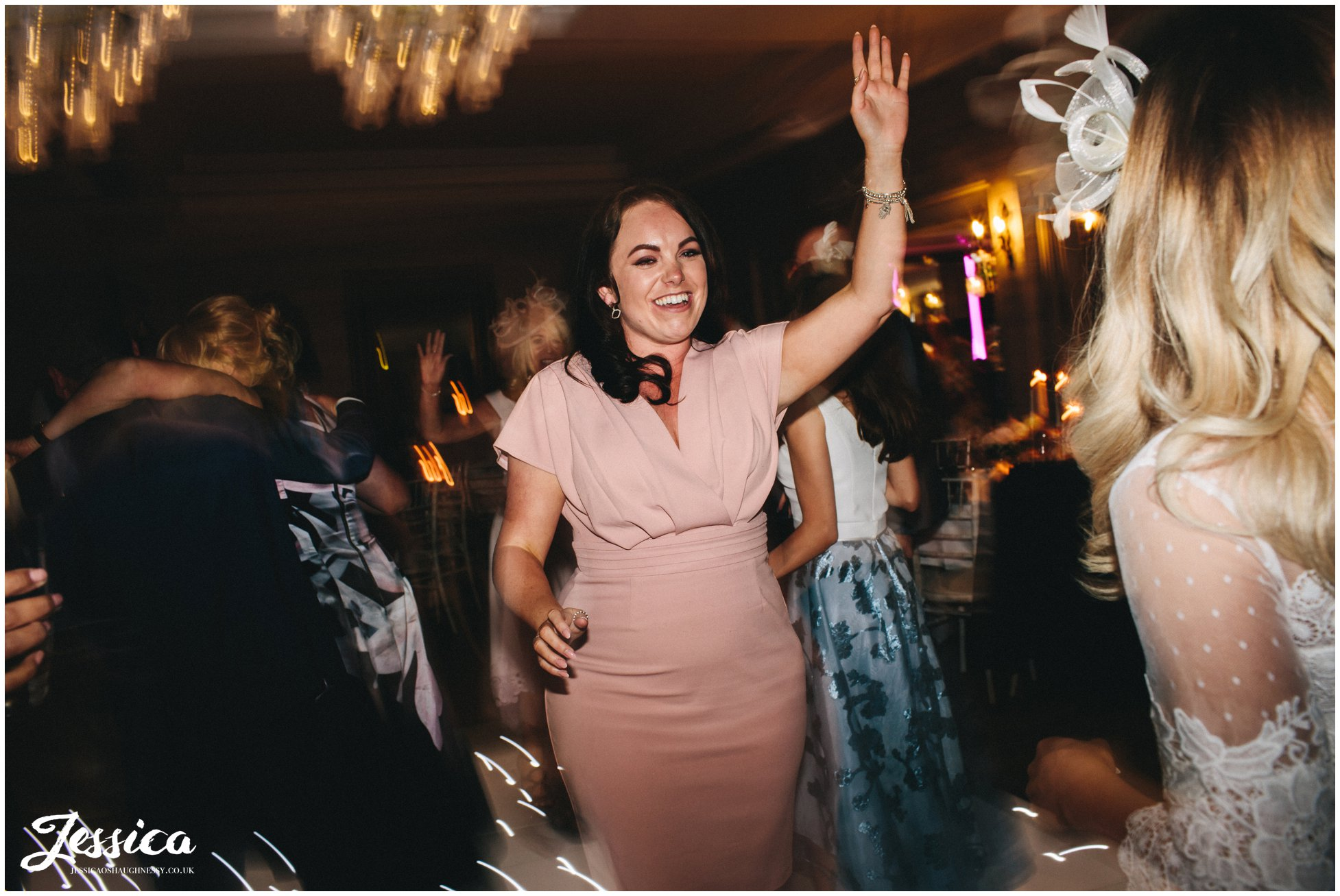 brides friends dance at brook hall hotel