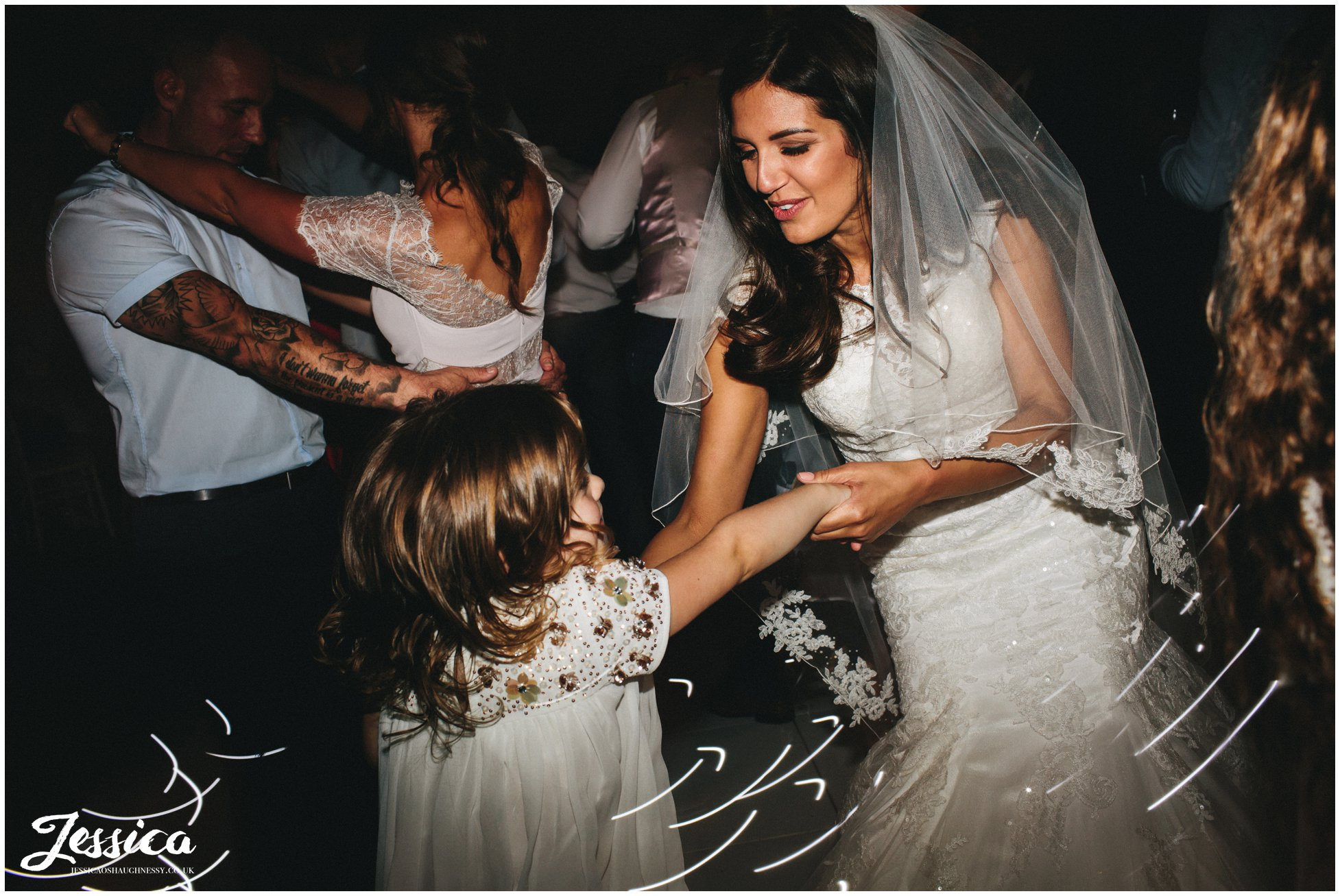 bride dances with her daughter at her wirral wedding reception
