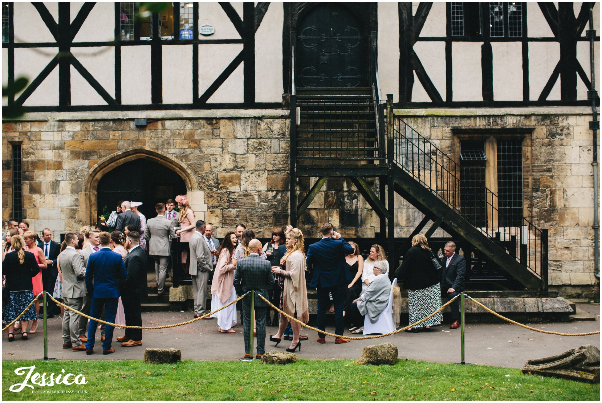 guests celebrate the marriage outside the hospitium in york