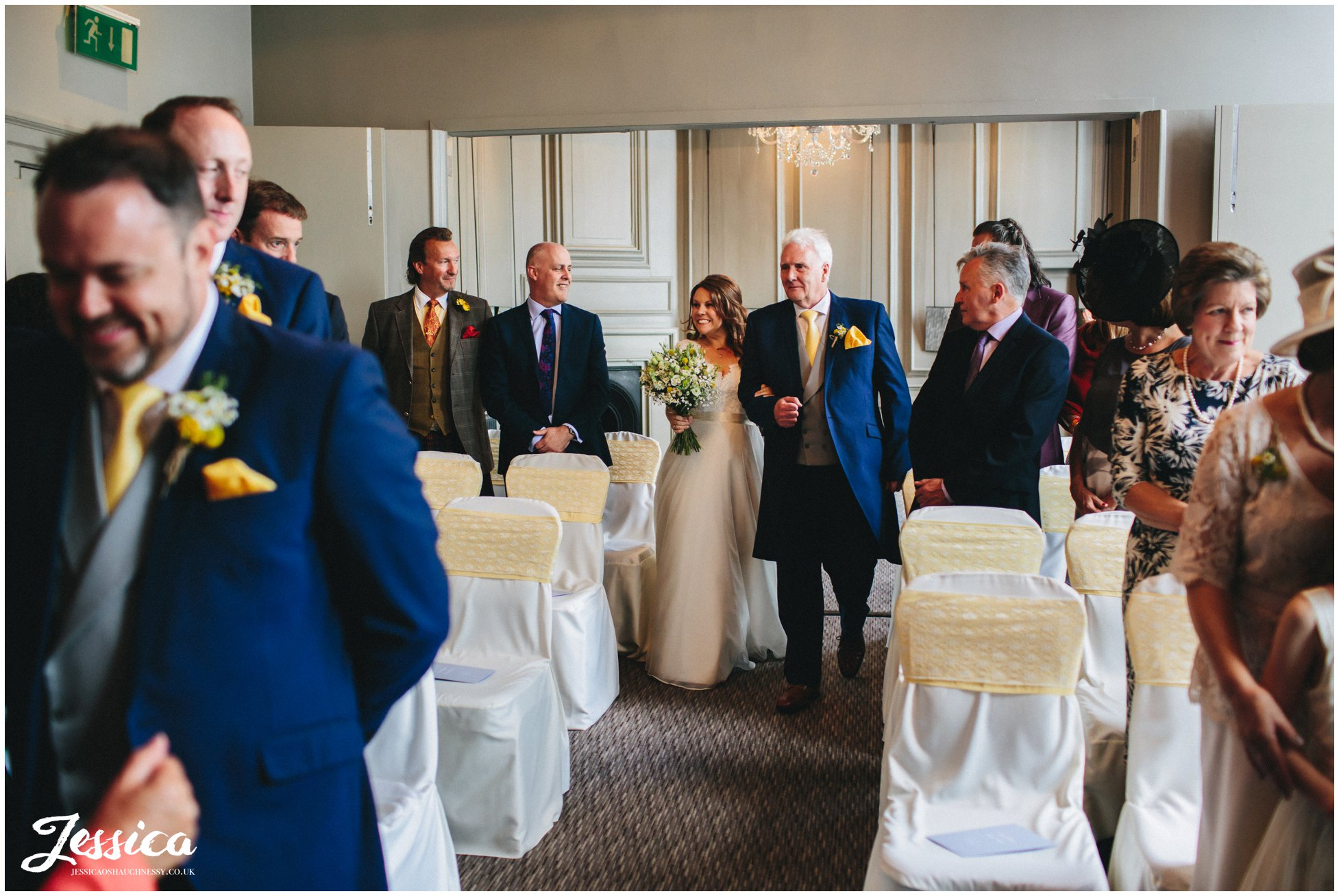 bride & her father walk down the aisle at oddfellows in chester