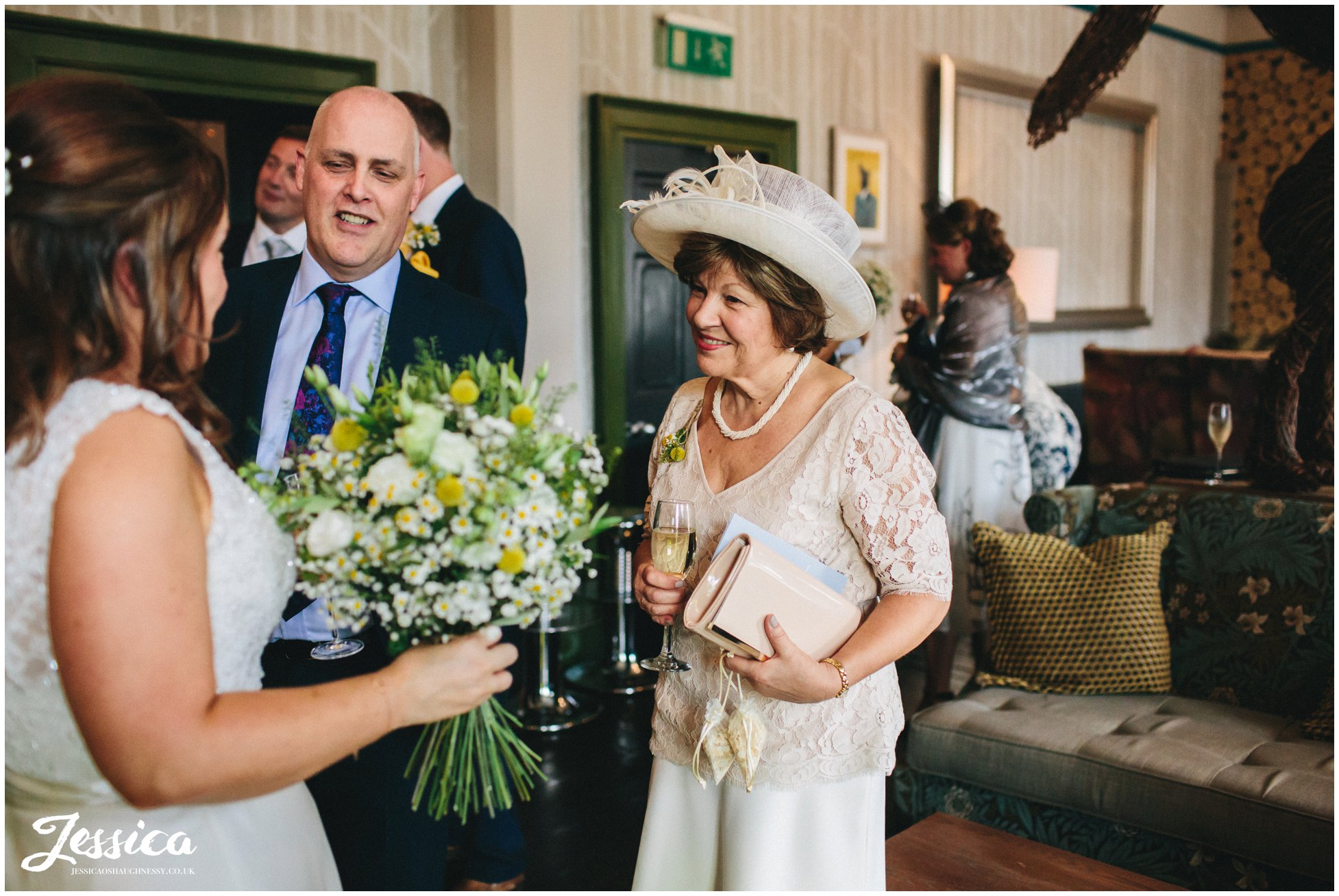 mother of the bride looks proudly at her married daughter