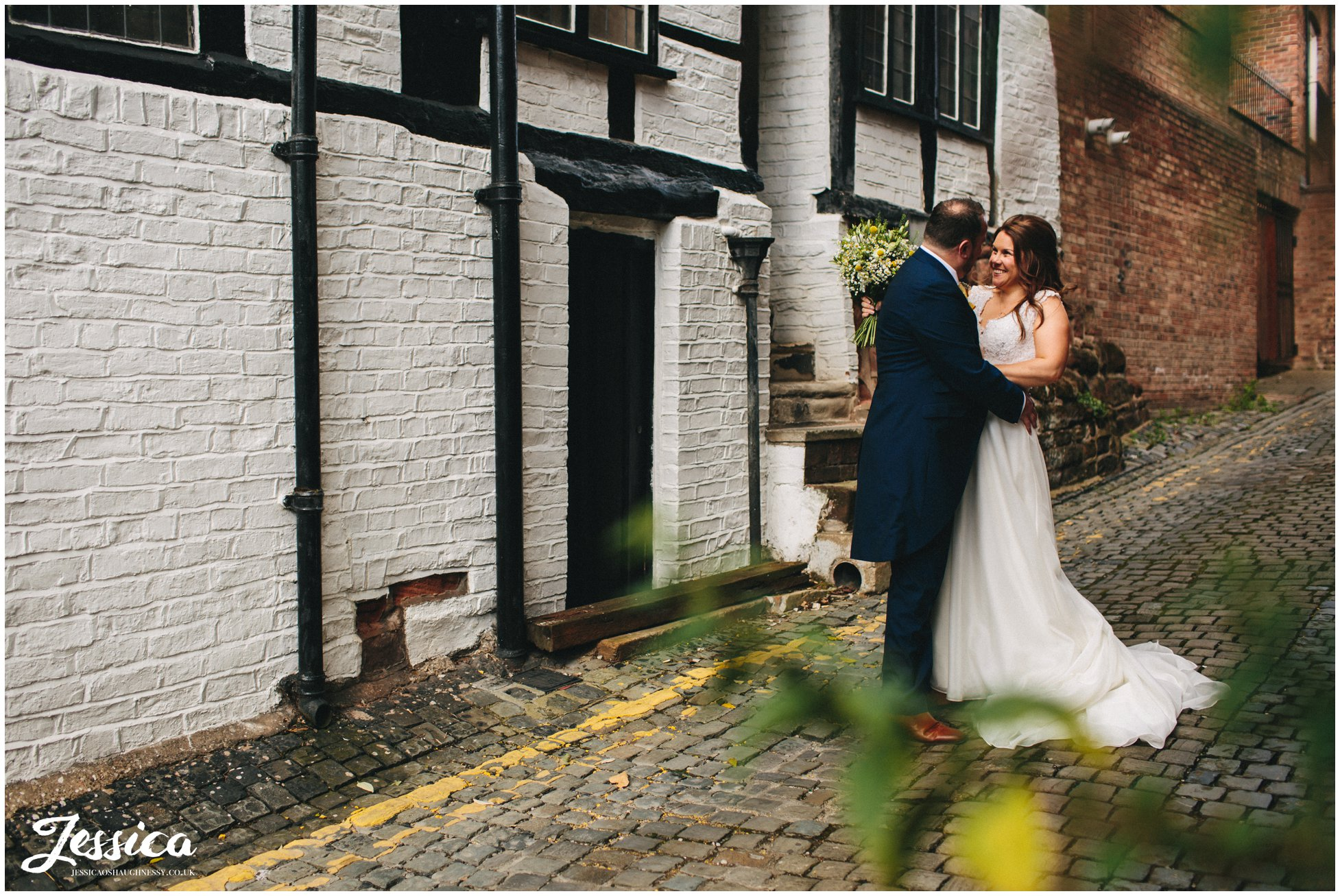 newlywed's kiss outside Oddfellows, their chester wedding venue