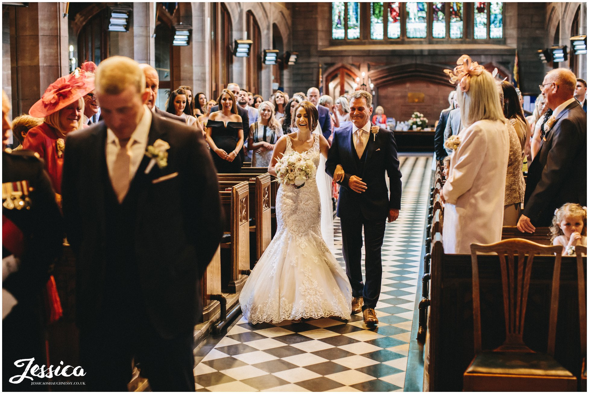 bride & father walk down christ churches aisle in port sunlight