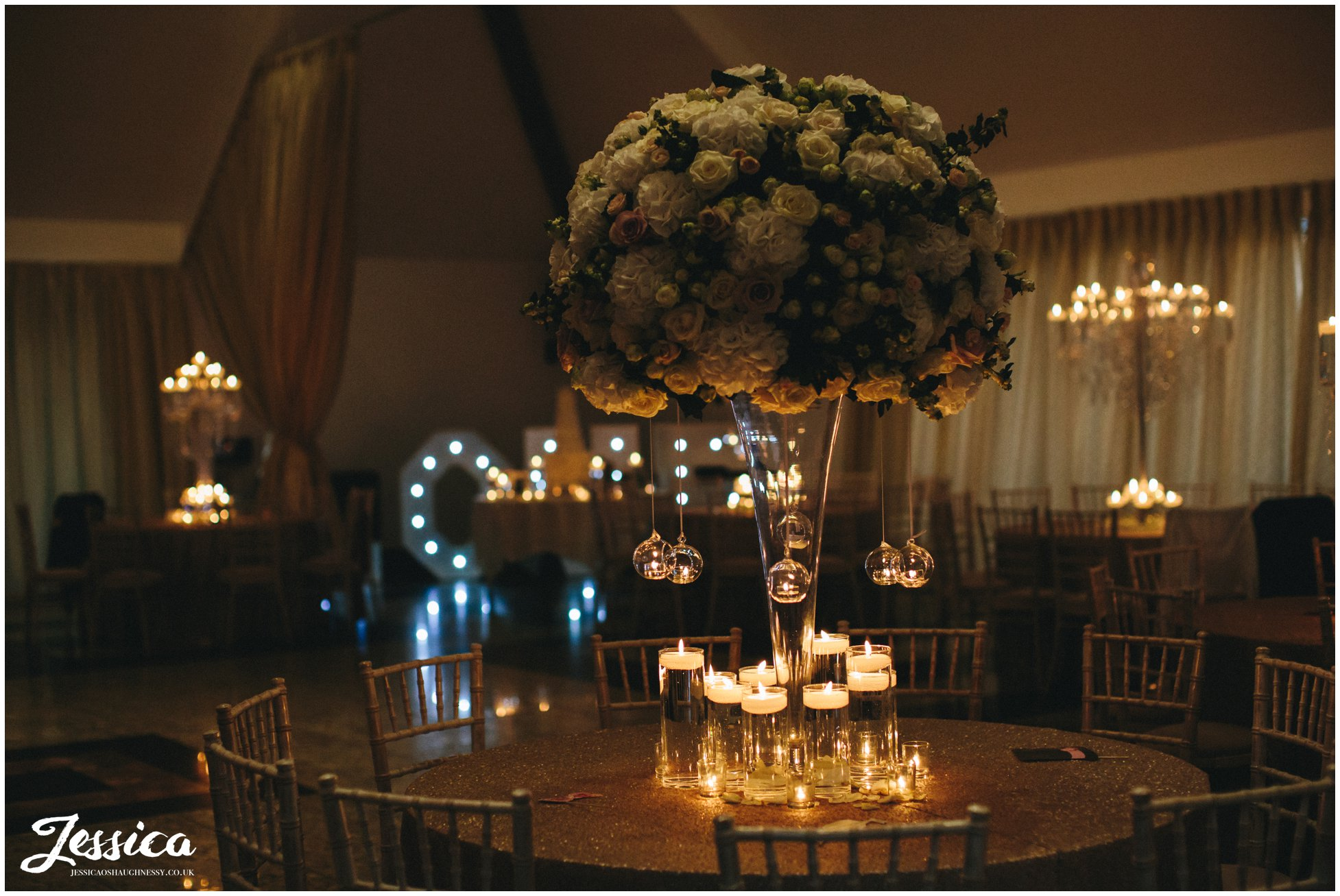 wedding room lit with candles ready for the reception