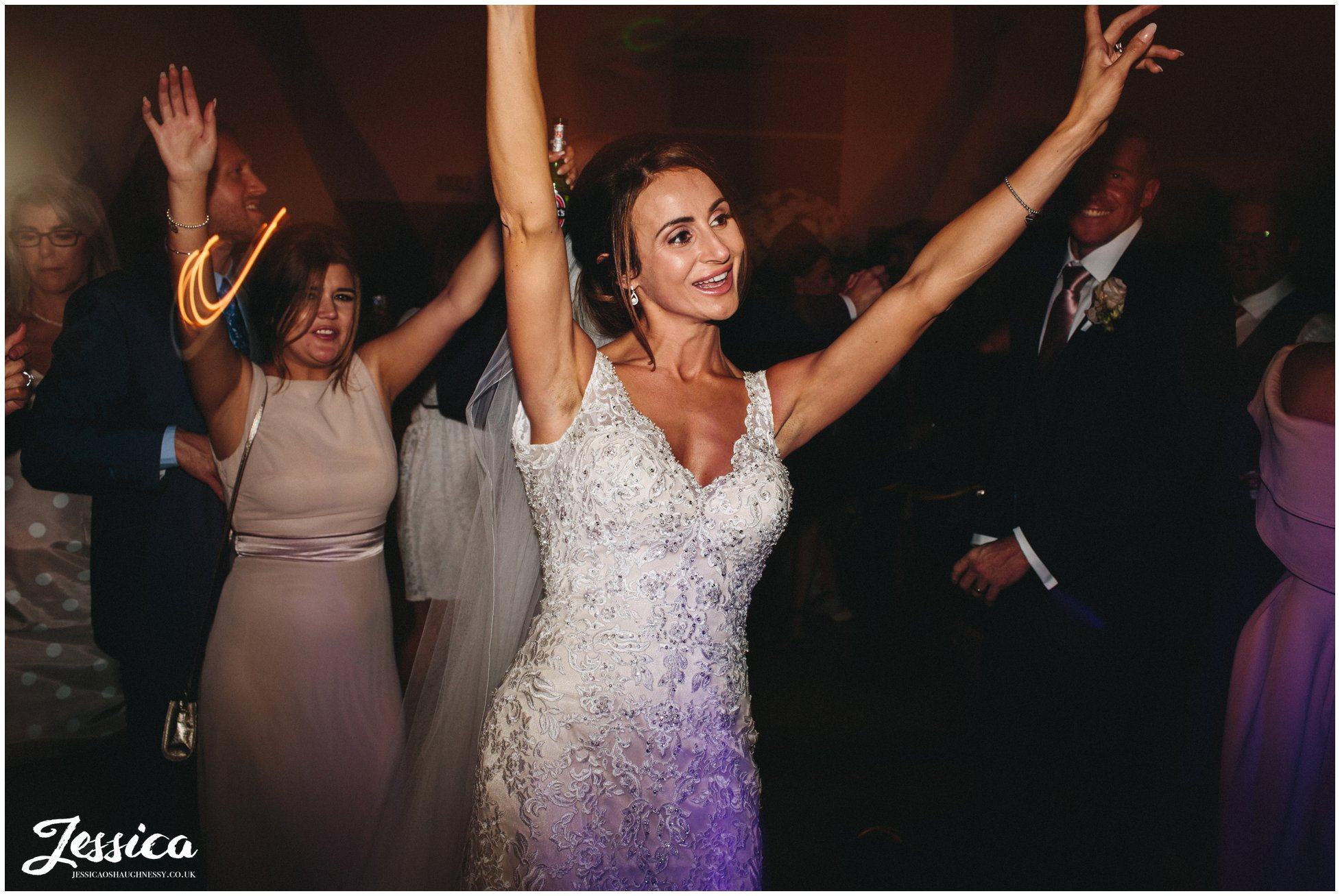 bride dances on her wedding day at the leverhulme hotel