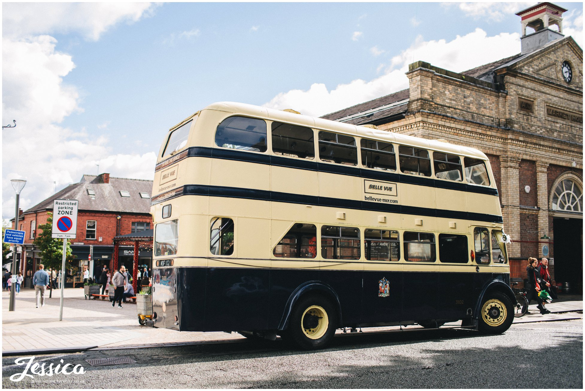 double decker bus parked outside the town hall