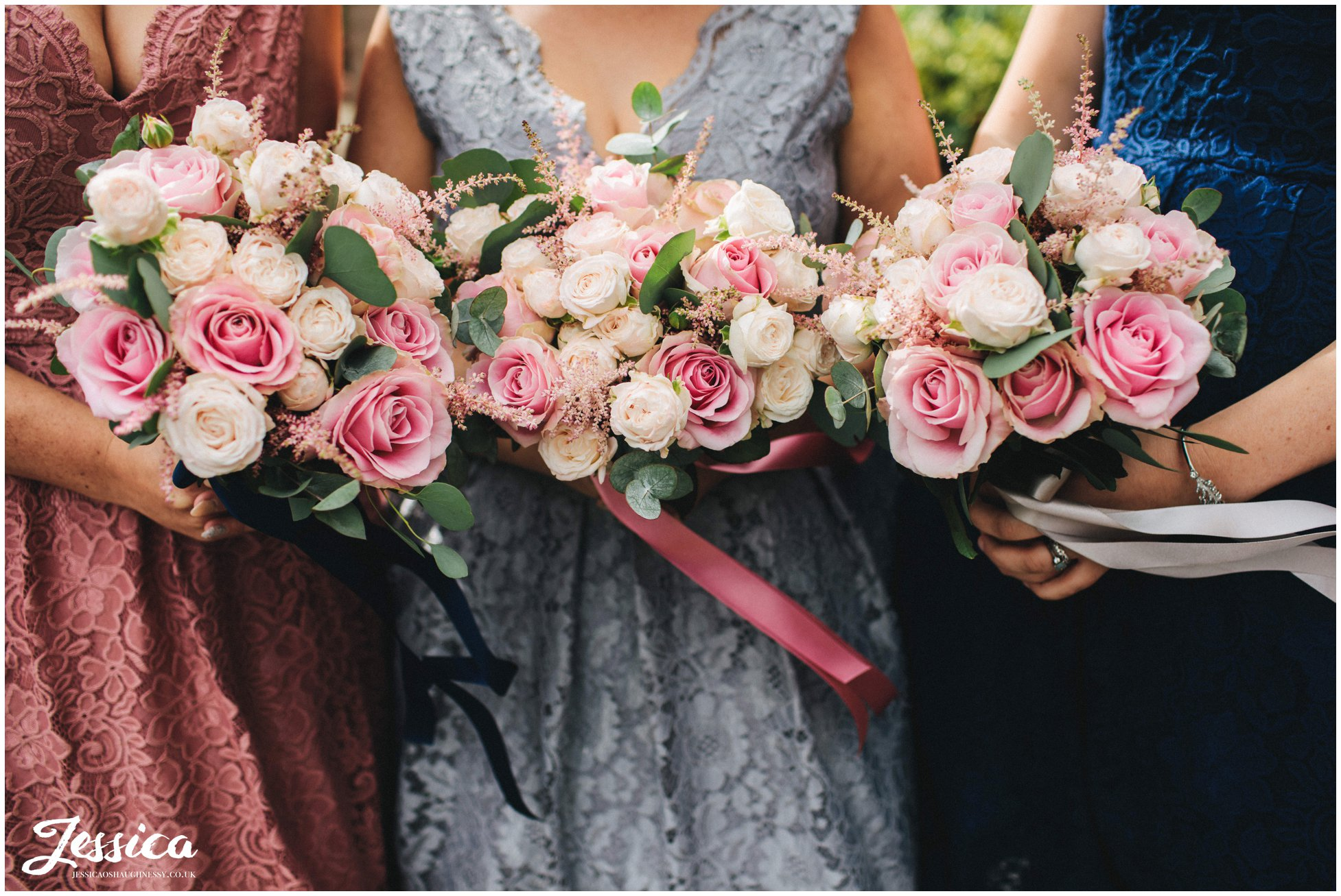 detail shot of bridesmaids holding their bouquets
