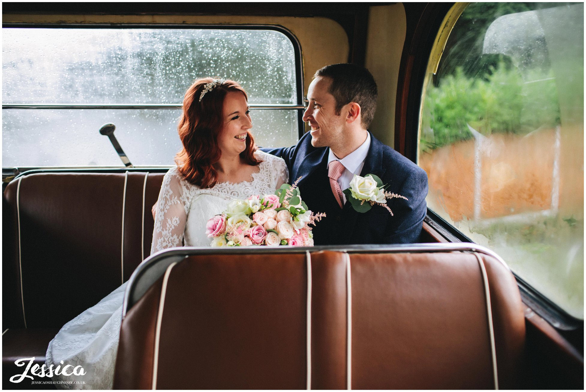 newly wed's sit on their wedding bus at their manchester wedding reception